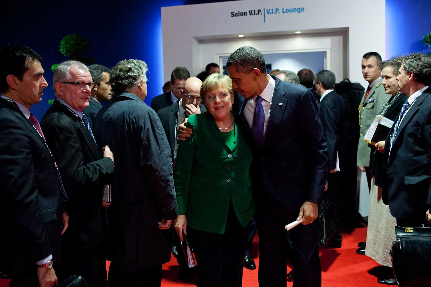 After a meeting with Eurozone leaders adjacent to the G20 Summit in Cannes, France, the President gave encouragement to German Chancellor Angela Merkel as they departed the meeting, Nov. 3, 2011.