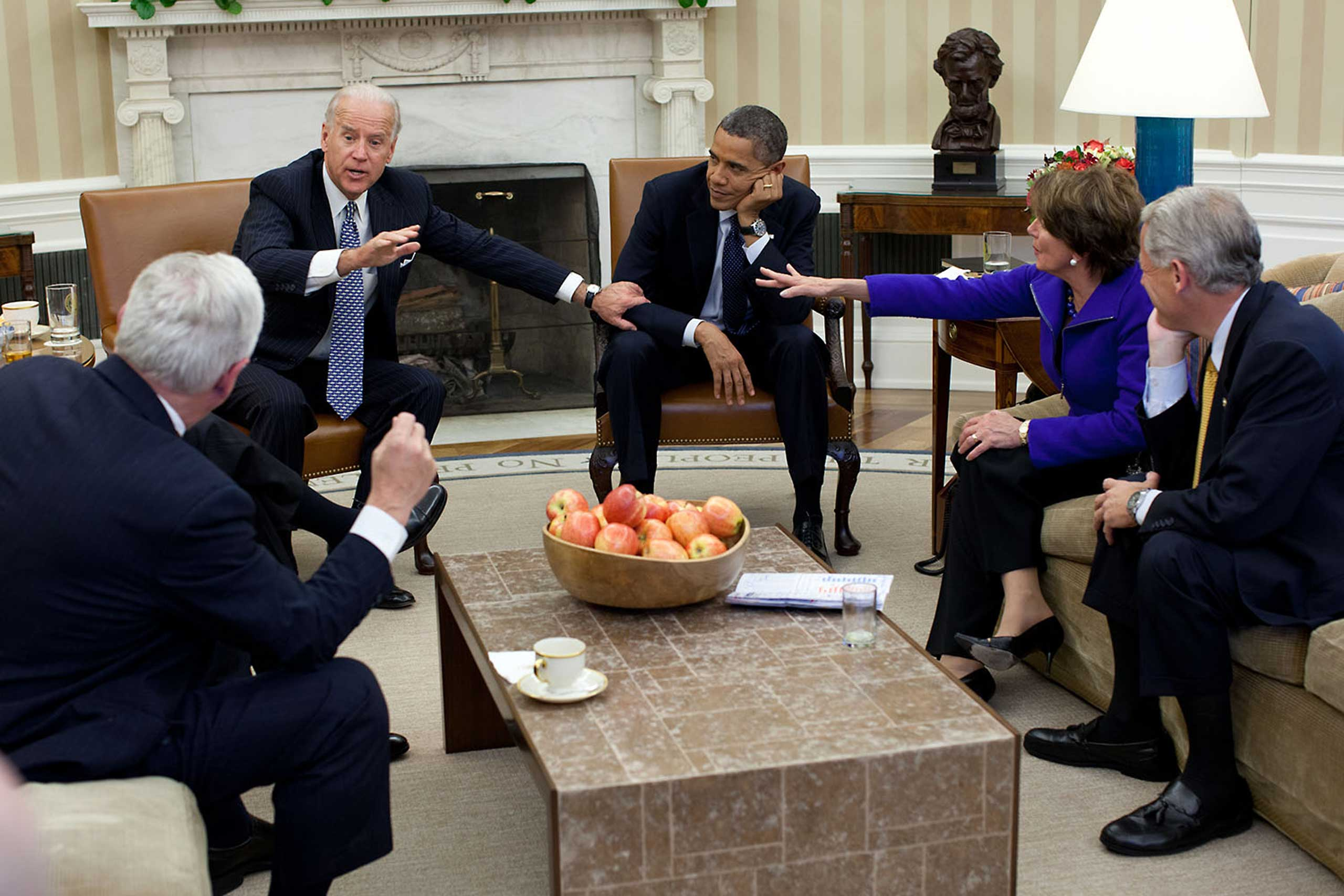 Usually the best moments at meetings are before and after the participants actually sit down. In this case, though, there was an interesting juxtaposition of gestures as the President and Vice President met with the House Democratic Leadership in the Oval Office, Nov. 1, 2011.