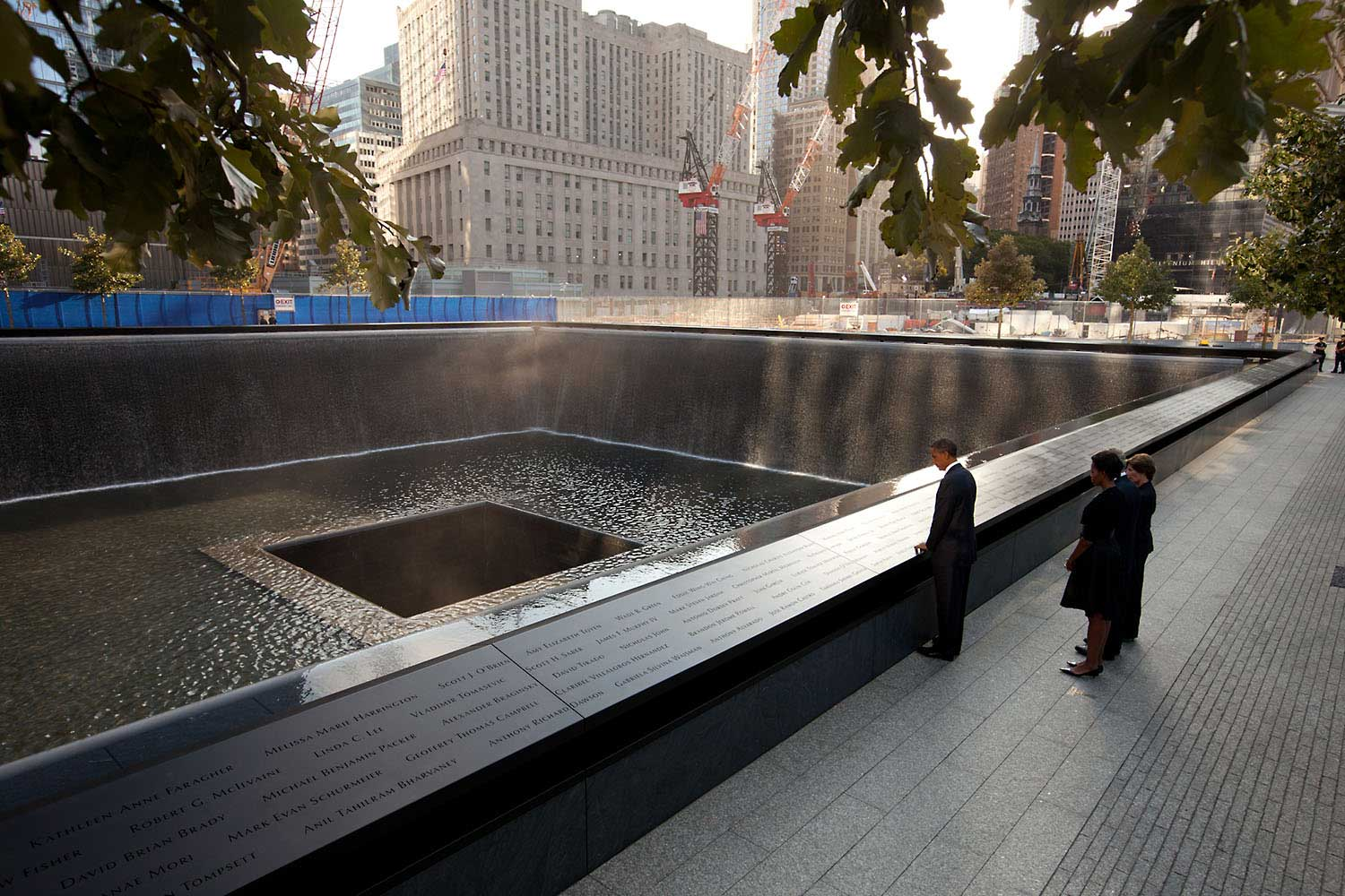 Chuck Kennedy captured this scene with a remote camera as the President and First Lady, along with former President George W. Bush and former First Lady Laura Bush, paused at the North Memorial Pool of the National September 11 Memorial in New York City. The North Memorial pool sits in the footprint of the north tower, formerly 1 World Trade Center.