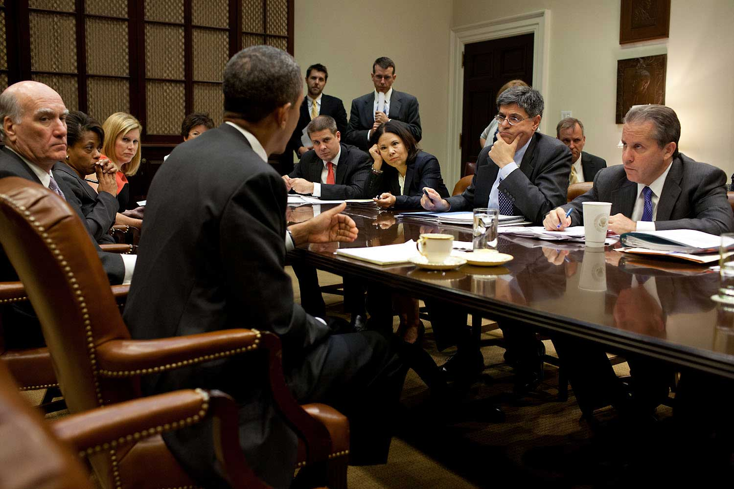 White House aides listen as President Obama makes a point during a meeting in the Roosevelt Room of the White House, Sept. 7, 2011.