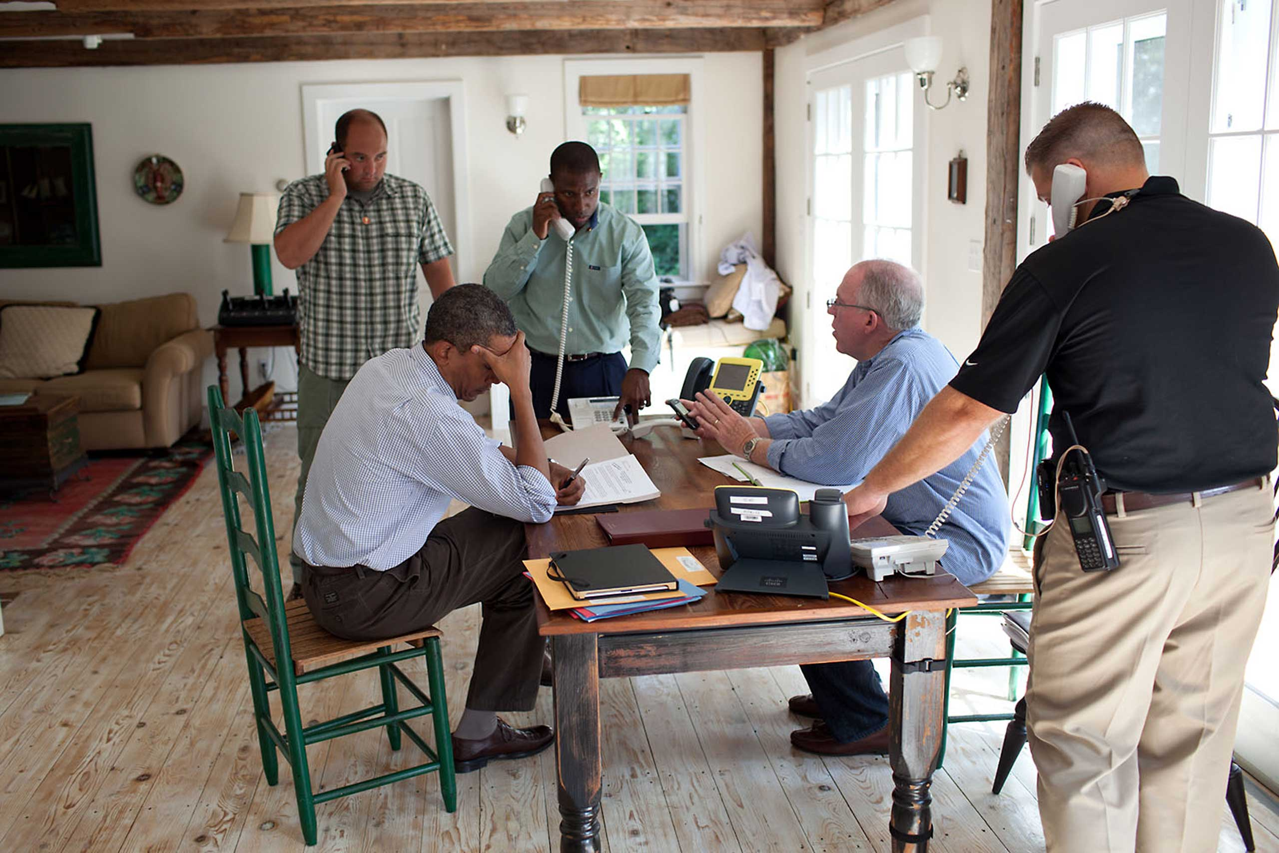 A former President once said, 'Presidents don't get vacations, they just get a change of scenery.' We were on 'vacation' in Martha's Vineyard and the President was monitoring Hurricane Irene with John Brennan, Assistant to the President for Homeland Security and Counterterrorism, at right in light blue shirt, on Aug. 26, 2011. They were waiting for a conference call on the hurricane with affected governors and mayors.