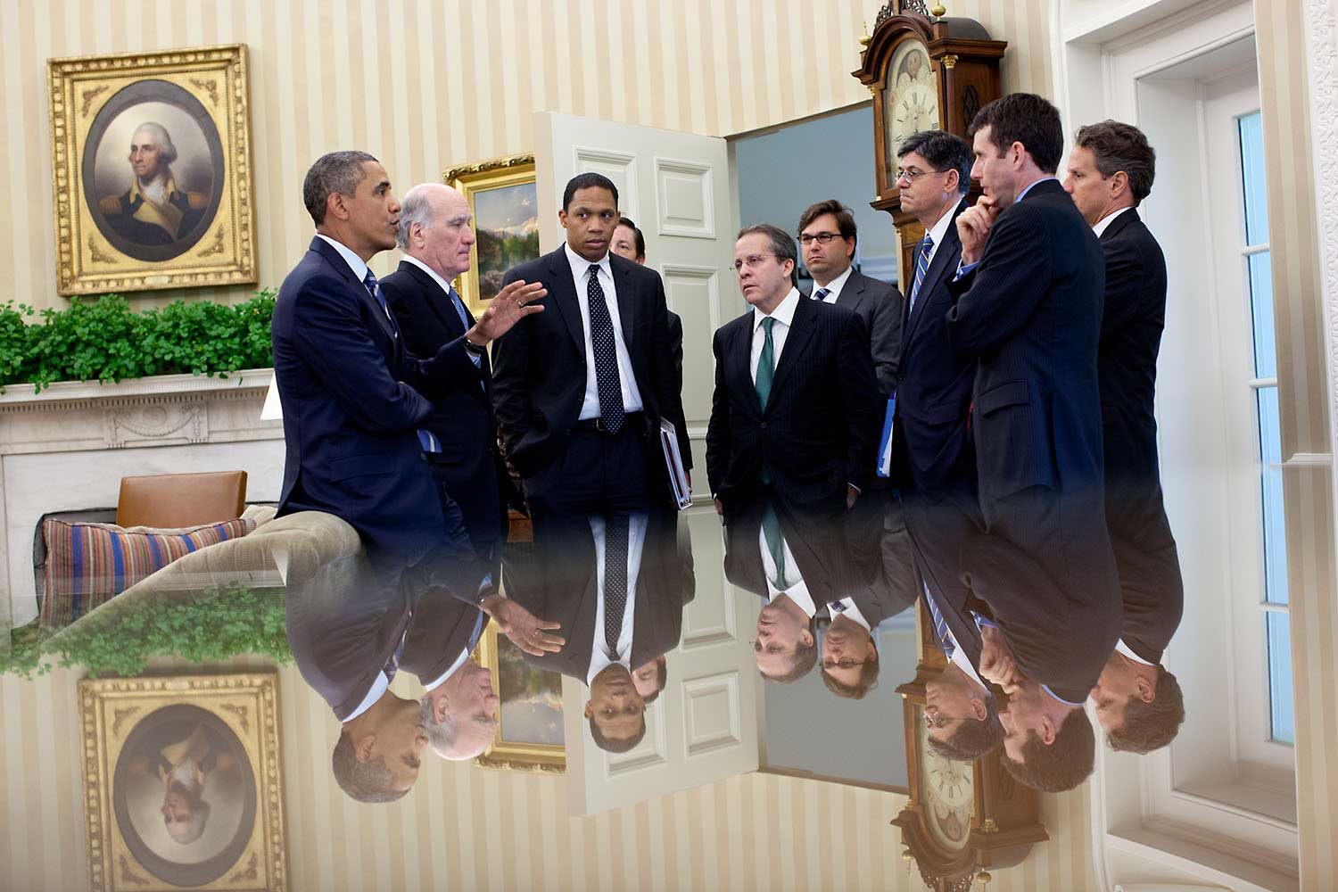 The reflection in this photo (since so many people ask me) was taken with my camera just above a small glass-topped table in the Oval Office as the President talked with members of his staff following a meeting with the Congressional leadership, July 7, 2011.