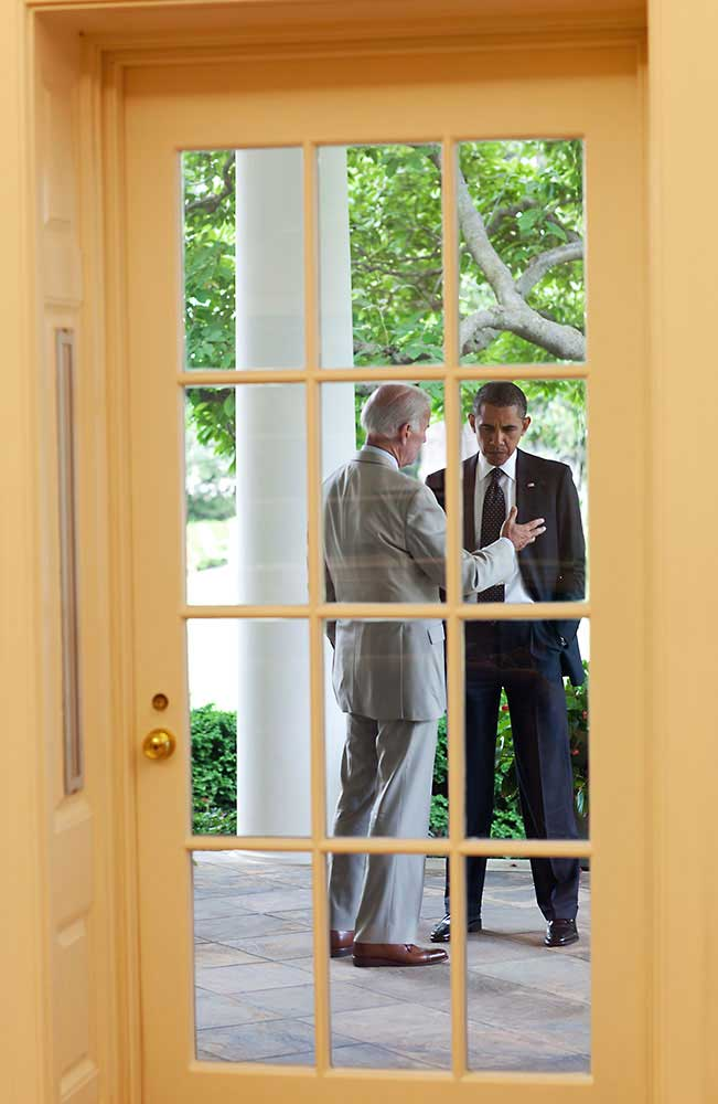 President Obama talks with Vice President Biden on the Colonnade outside the Oval Office, June 20, 2011.