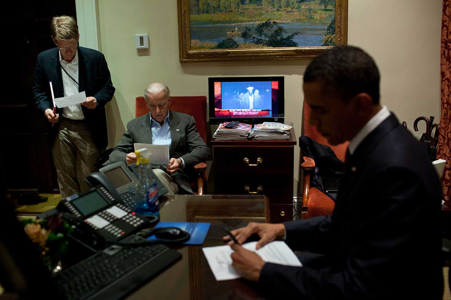 President Barack Obama edits his remarks in the Outer Oval Office prior to making a televised statement detailing the mission against Osama bin Laden, May 1, 2011. Vice President Biden, Press Secretary Jay Carney and are also pictured.