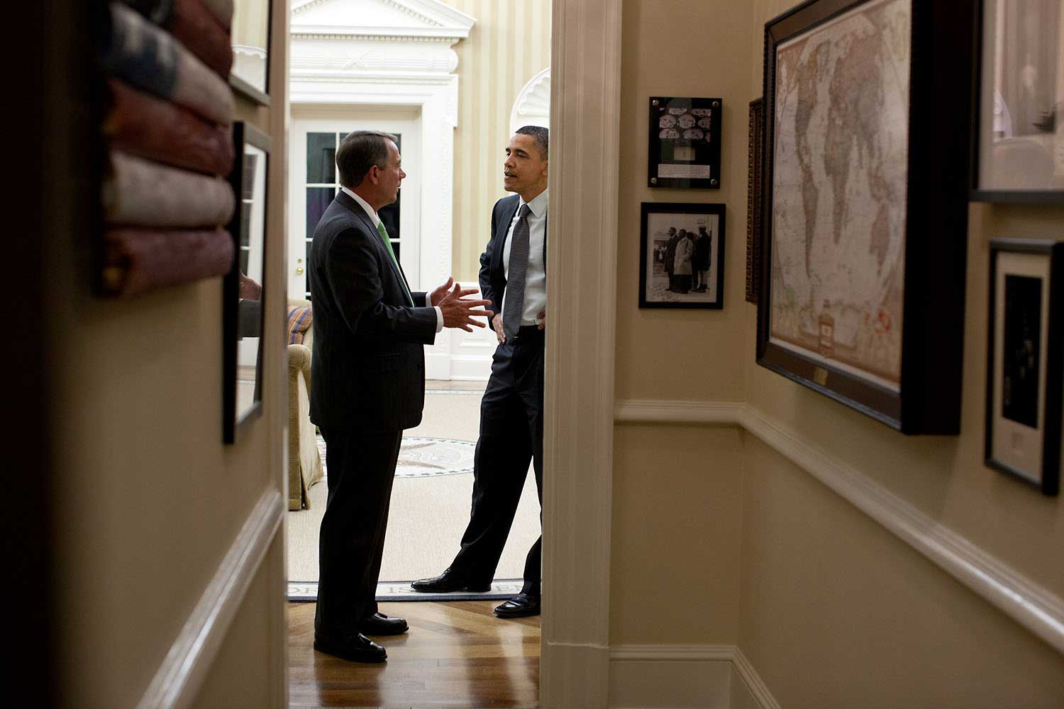 President Obama and House Speaker John Boehner talk in the Oval Office following a late night meeting on the budget, April 6, 2011.