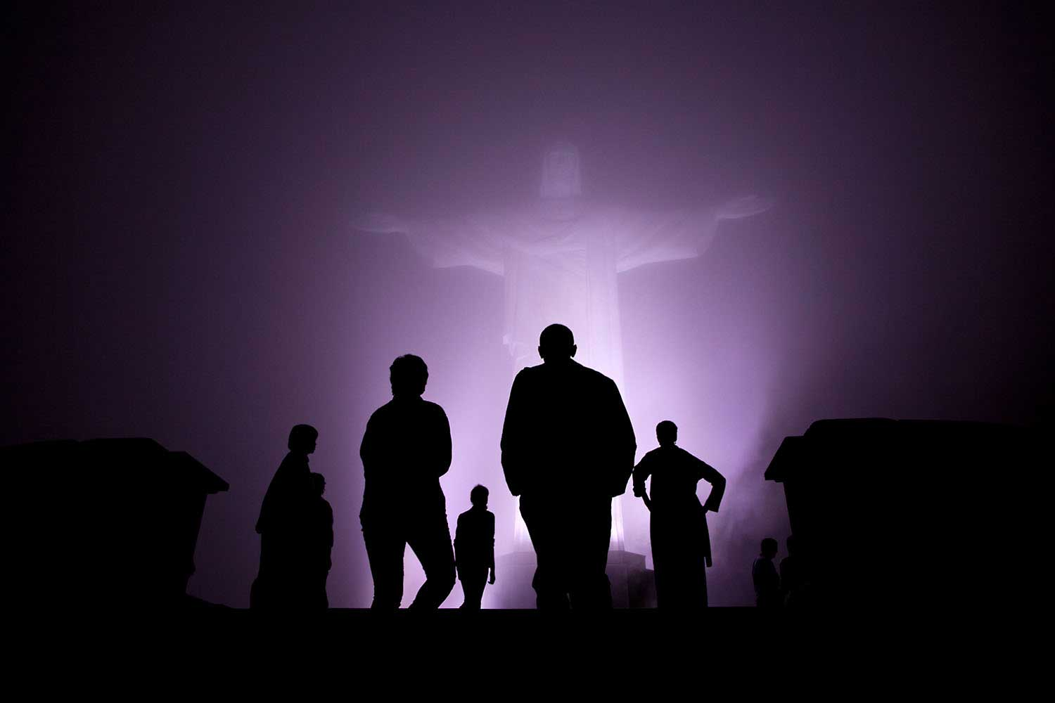 The Obama family was scheduled to tour the Christ the Redeemer statue in Rio de Janeiro, Brazil, before dinner one night March 20, 2011. But when heavy fog rolled in, they decided to cancel the visit. After dinner though, the fog had dissipated somewhat so they decided to make the drive up the mountain after all. It was quite clear when they arrived and then the fog started to roll back in. I managed to capture this silhouette as they viewed the statute one last time just before departure.