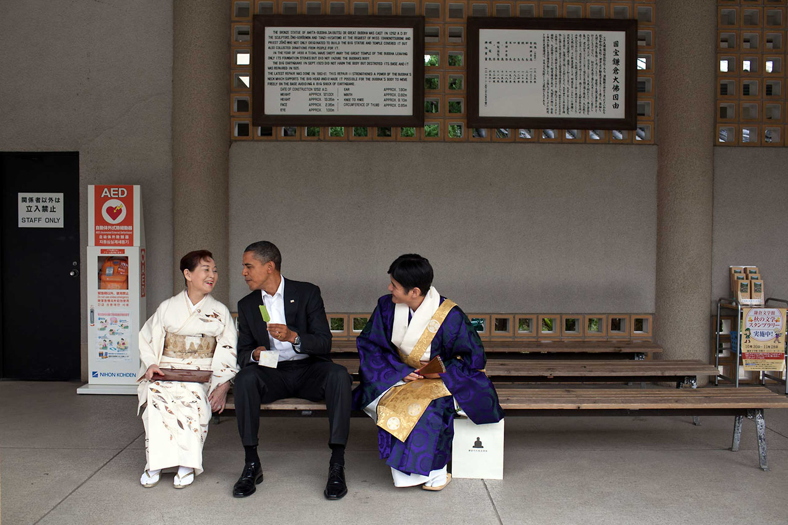 Visiting the Great Buddha of Kamakura, in Japan, the President had a green tea ice cream bar with his hosts, Nov. 14, 2010. He had visited this Buddha as a young child and said he remembered sitting in the exact same place having an ice cream bar.