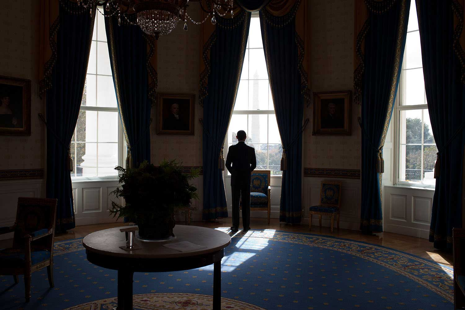 The day after the mid-term election, the President waits in the Blue Room of the White House before facing the press at a news conference in the East Room, Nov. 3, 2010.