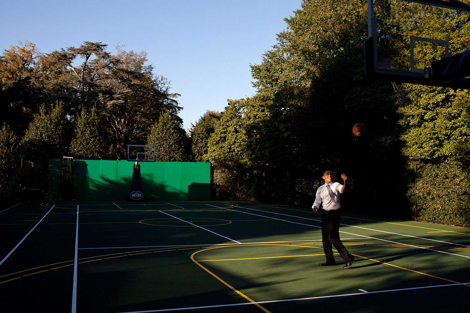 After a day filled with meetings, the President headed to the White House basketball court to shoot a few baskets with his personal aide Reggie Love, Oct. 13, 2010. Before heading back to the Oval, he flipped the ball towards the rim just where the afternoon light was falling.