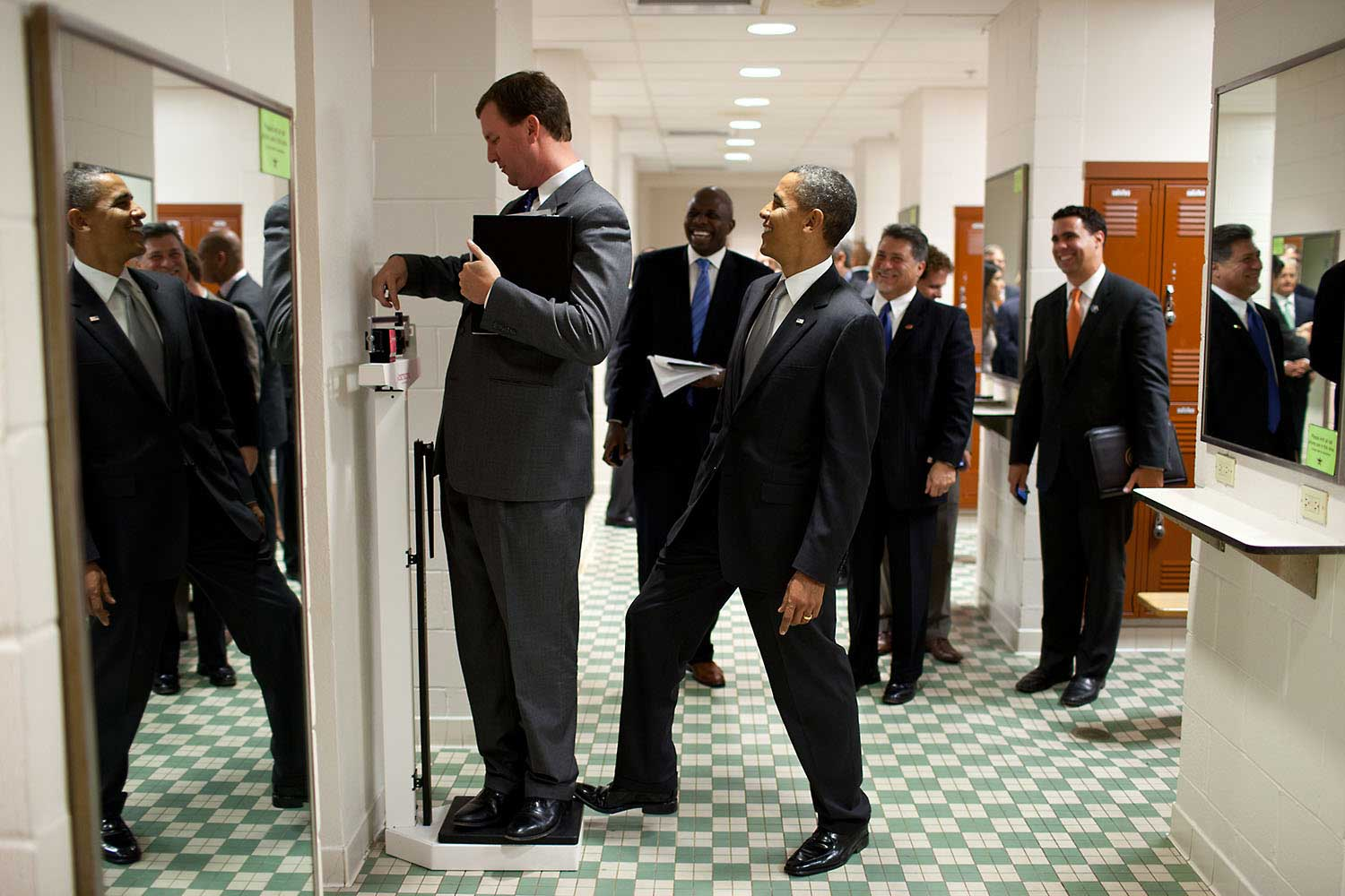 We were walking through a locker room at the University of Texas on August 9, 2010, when White House Trip Director Marvin Nicholson stopped to weigh himself on a scale. Unbeknownst to him, the President was stepping on the back of the scale, as Marvin continued to slide the scale lever. Everyone but Marvin was in on the joke.