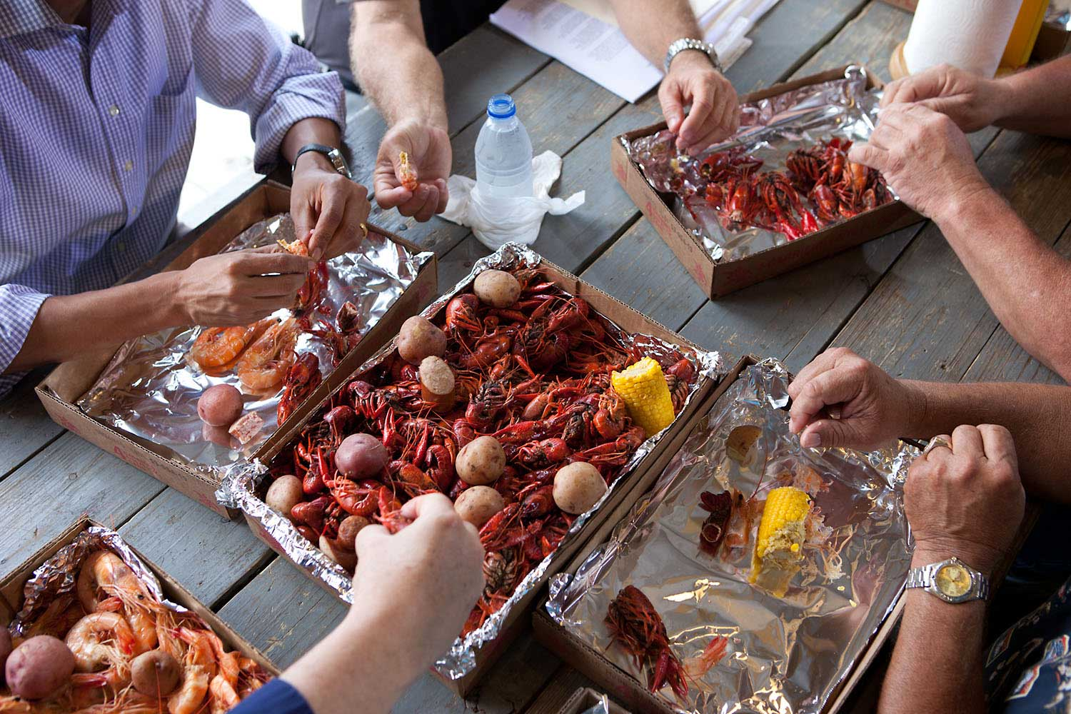 To call attention to the safety of the seafood in the Gulf Coast after the BP oil spill, the President ate some shrimp and crawfish with locals in Grand Isle, La., June 4, 2010. I noticed all the hands digging into the food and thought it made an interesting angle.