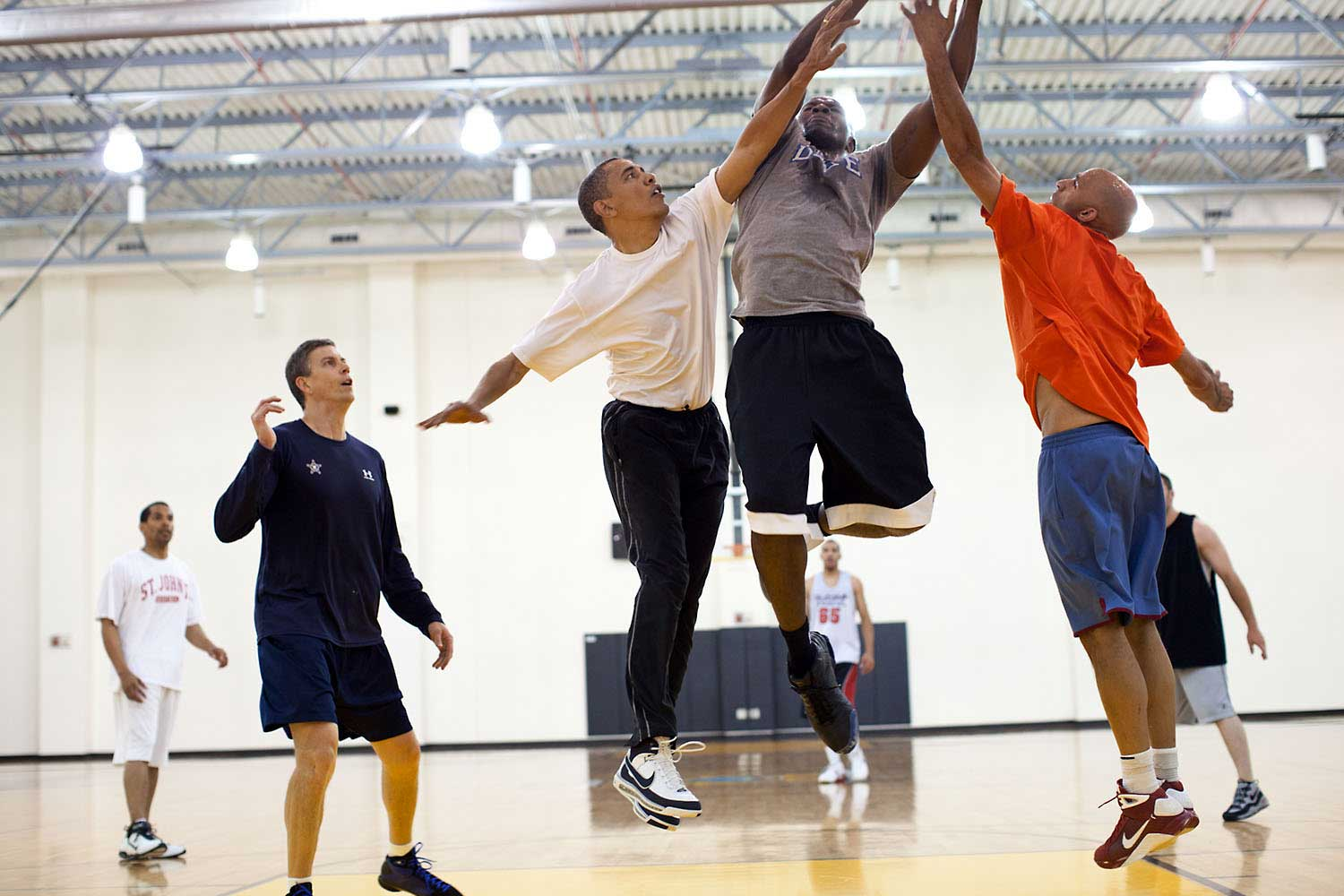 President Obama tries to block a layup shot by his former personal aide, Reggie Love, at Fort McNair in Washington, D.C., May 16, 2010.
