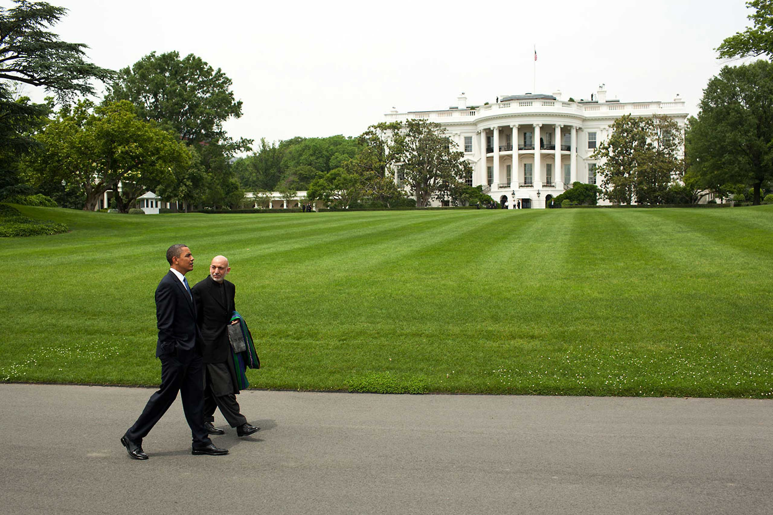 President Obama and President Hamid Karzai of Afghanistan walk along the South Lawn Drive of the White House, following their working lunch, May 12, 2010.