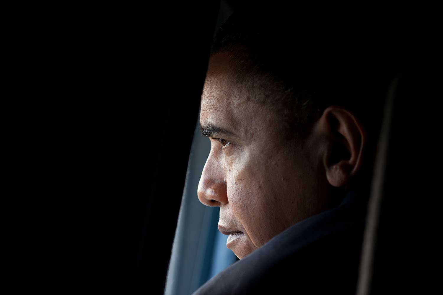President Obama looks out the window aboard the Marine One helicopter before speaking at Hampton University commencement in Armstrong Stadium, Hampton, Va. May 9, 2010.