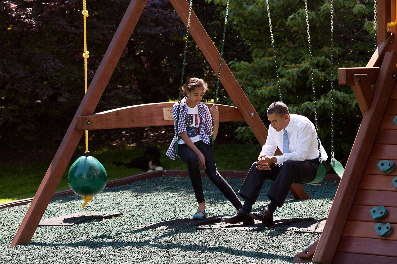President Obama talks with his daughter Malia on the swing set outside the Oval Office, May 4, 2010.