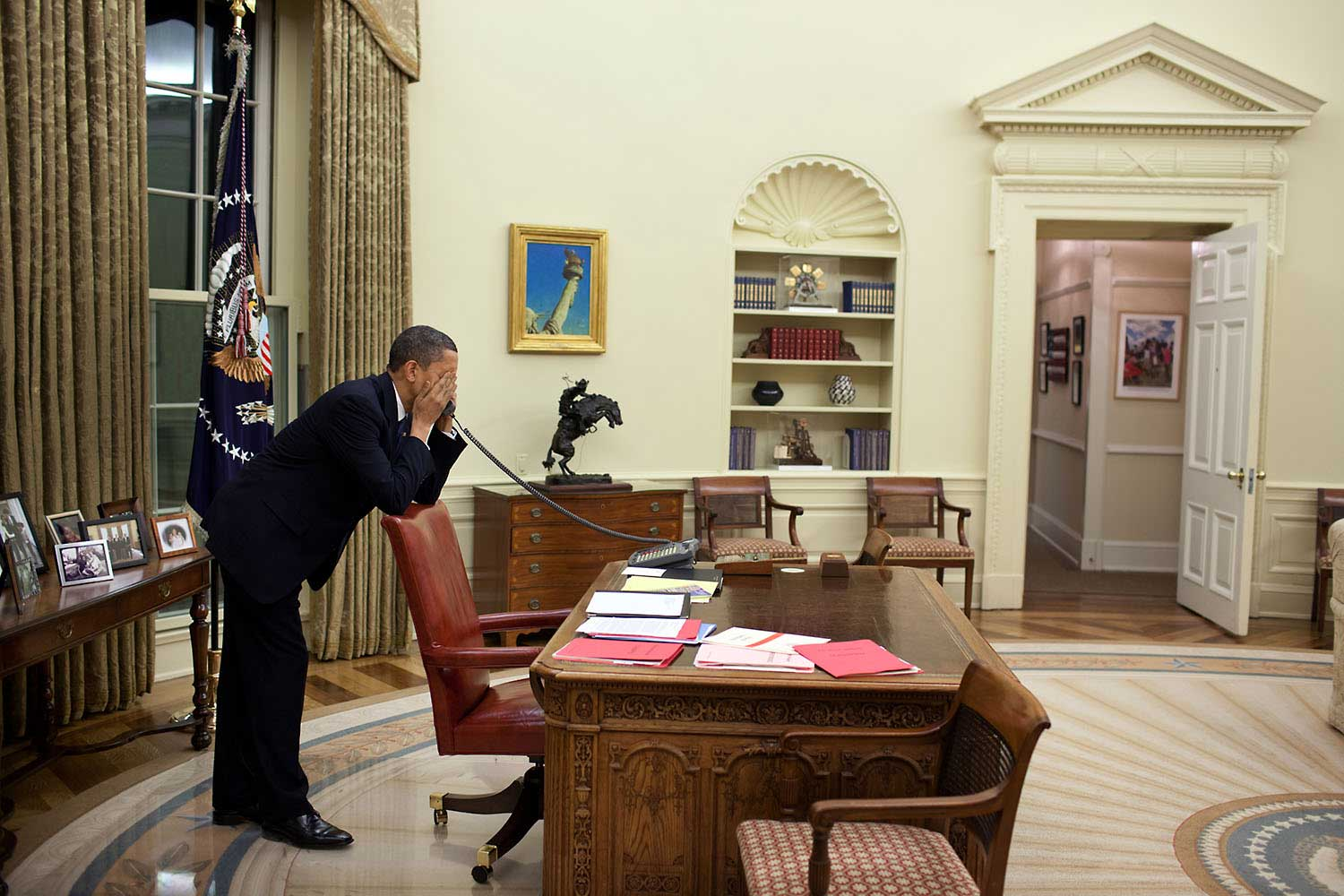 After dinner with his family on March 19, 2009, the President works the phone in the Oval Office to continue pressing Congressmen to vote for the health care reform bill.