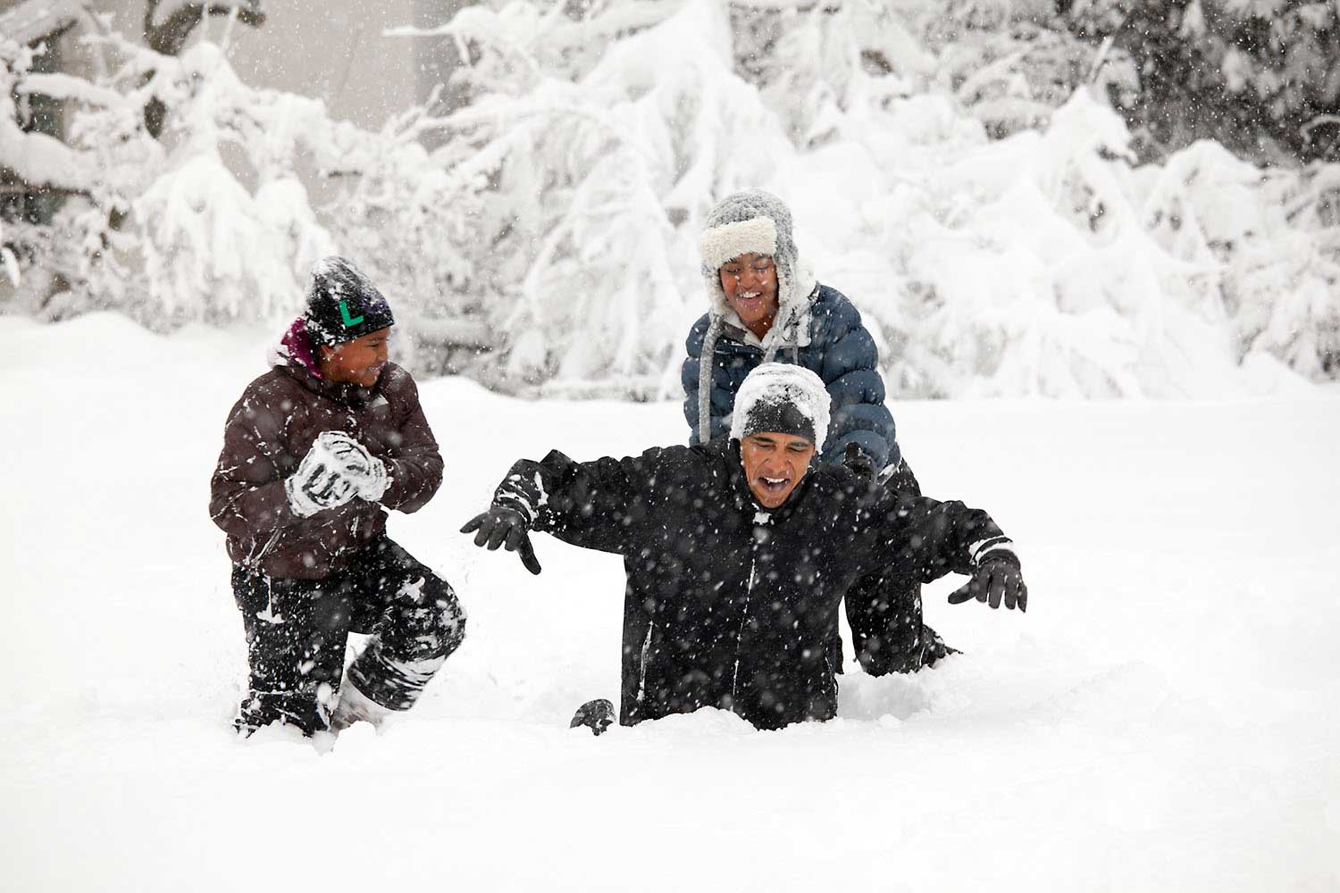 President Barack Obama and his daughters, Sasha and Malia, play in the snowstorm at the White House, Saturday, Feb. 6, 2010.