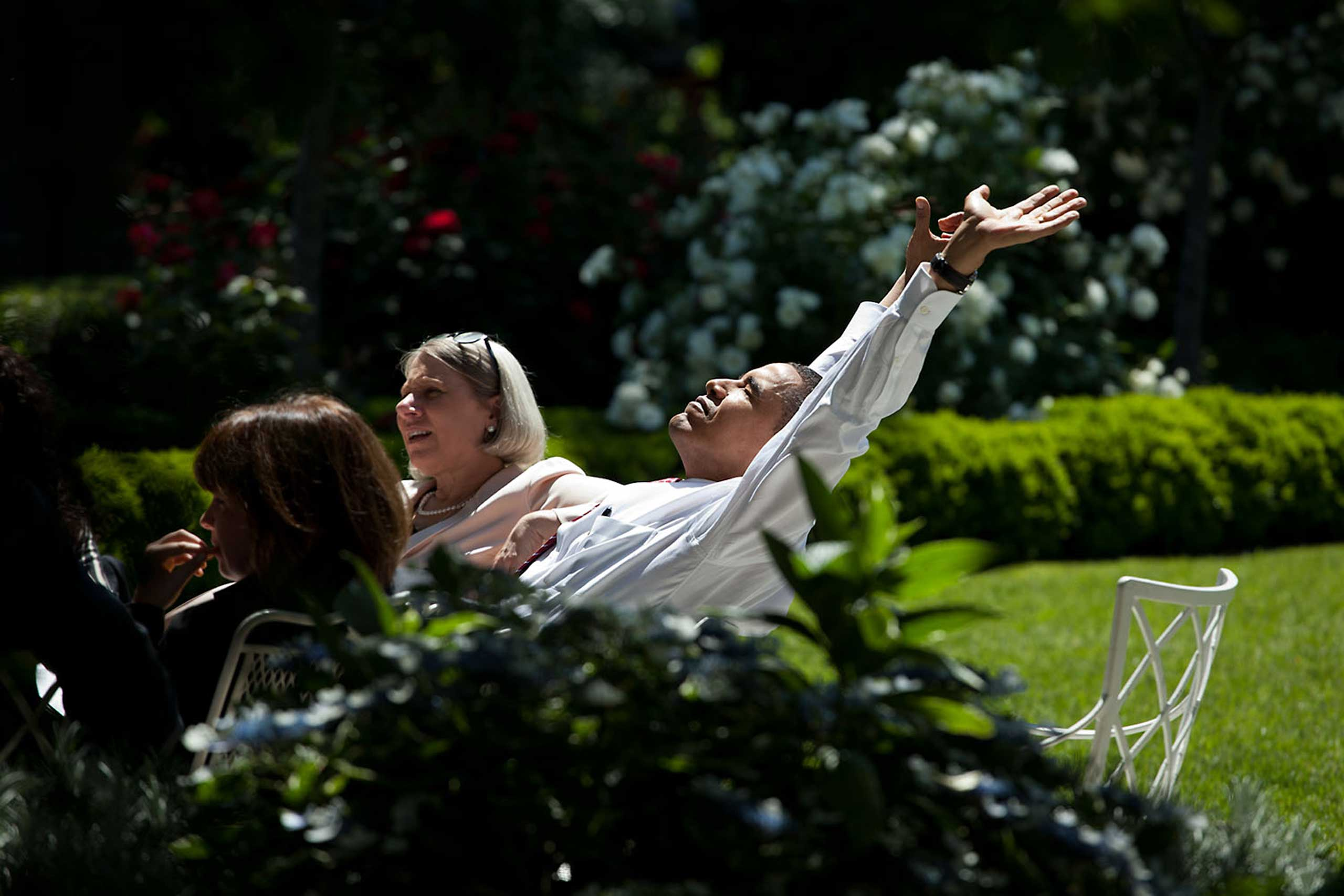 The President stretches during a senior advisors meeting in the Rose Garden, May 20, 2009.