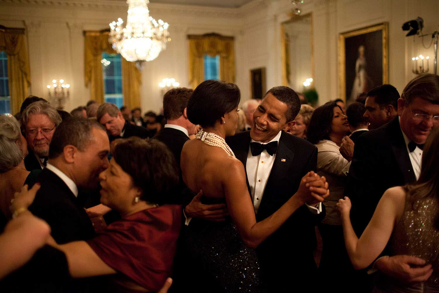 The President dances with his wife while singing along with the band Earth, Wind & Fire during the Governors Ball, his first formal function at the White House, on Feb. 22, 2009