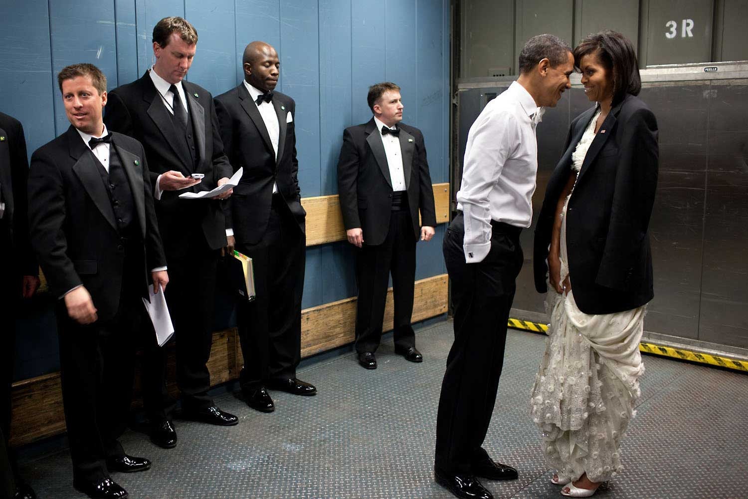 """We were on a freight elevator headed to one of the Inaugural balls on Jan. 20, 2009. It was quite chilly, so the President removed his tuxedo jacket and put it over the shoulders of his wife. Then they had a semi-private moment as staff members and Secret Service agents tried not to look."""