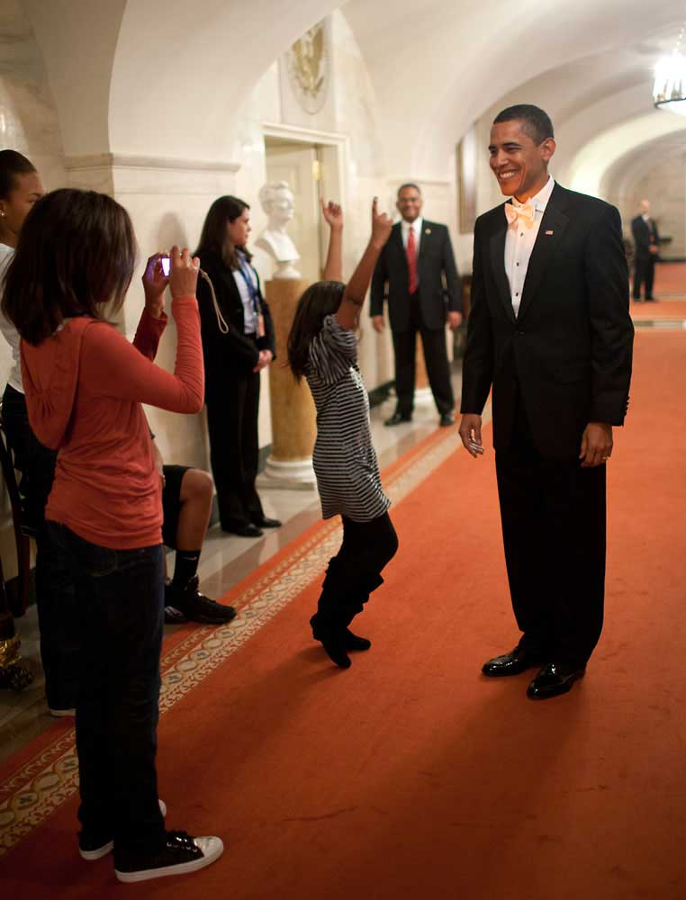 Malia Obama takes a picture of her father, President Obama, at the White House prior to his departure for the Inaugural Balls, Jan. 20, 2009.