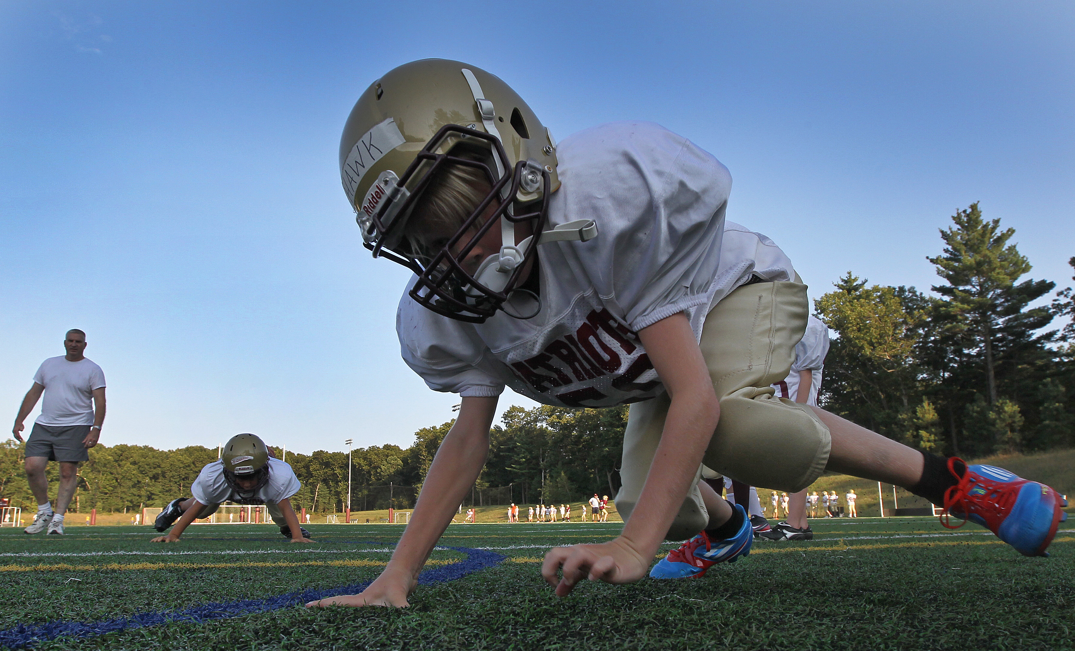 Concord-Carlisle Pop Warner football players go through drills during practice.