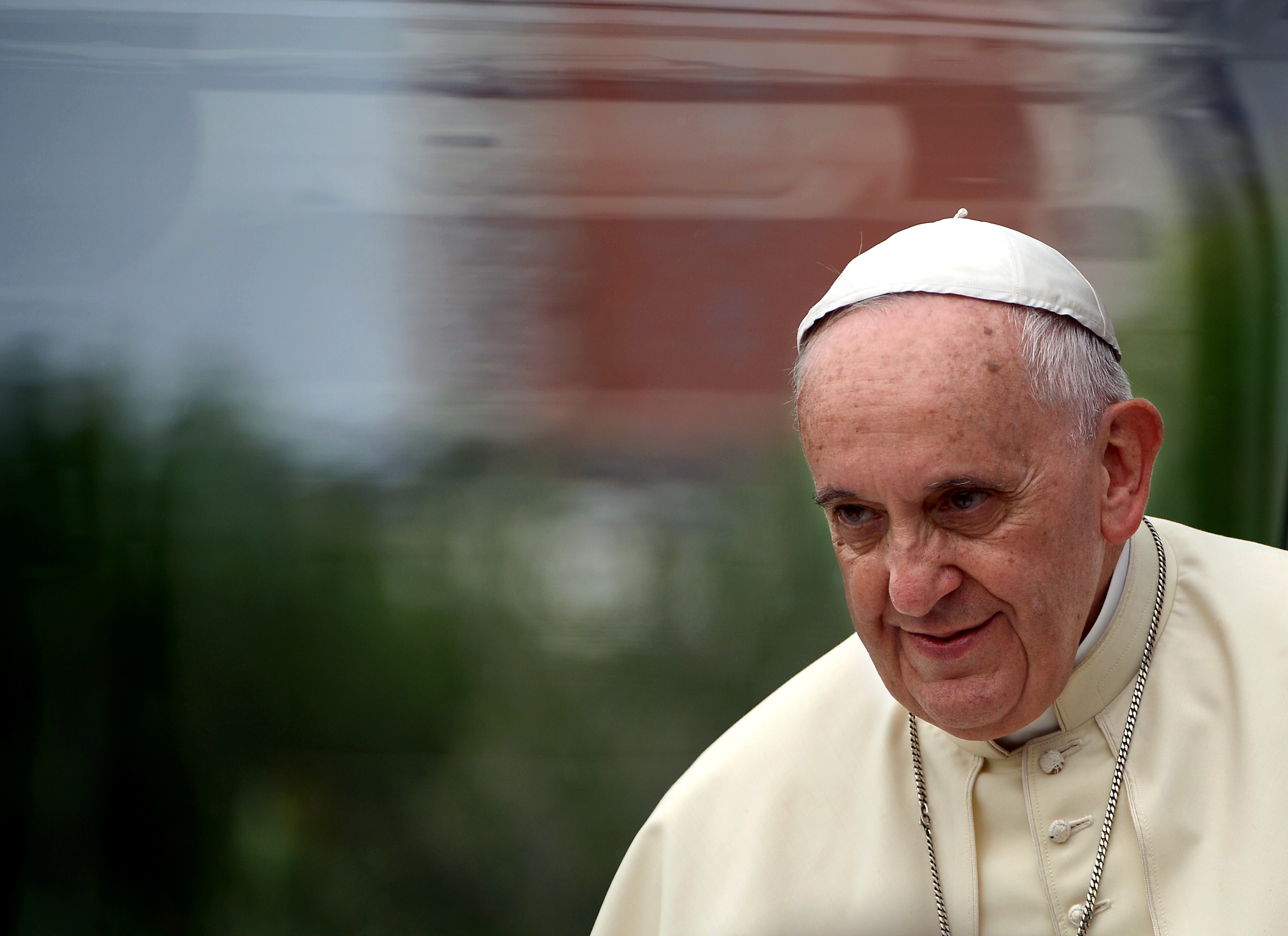 Pope Francis arrives with his popemobile at the Catholic University in Tirana, on September 21, 2014.