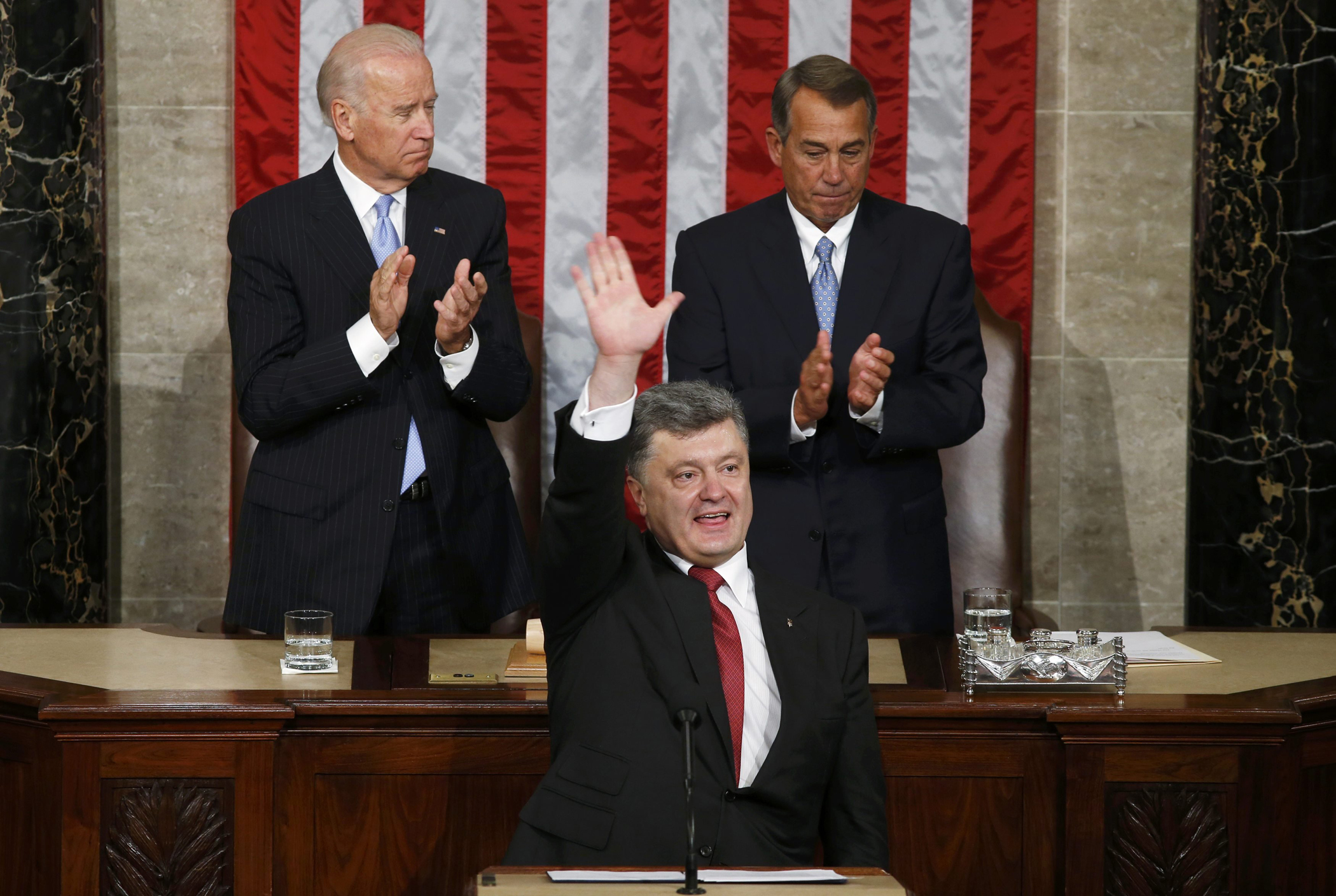 Ukraine President Petro Poroshenko acknowledges applause after addressing a joint meeting of Congress in the U.S. Capitol in Washington, Sept. 18, 2014.