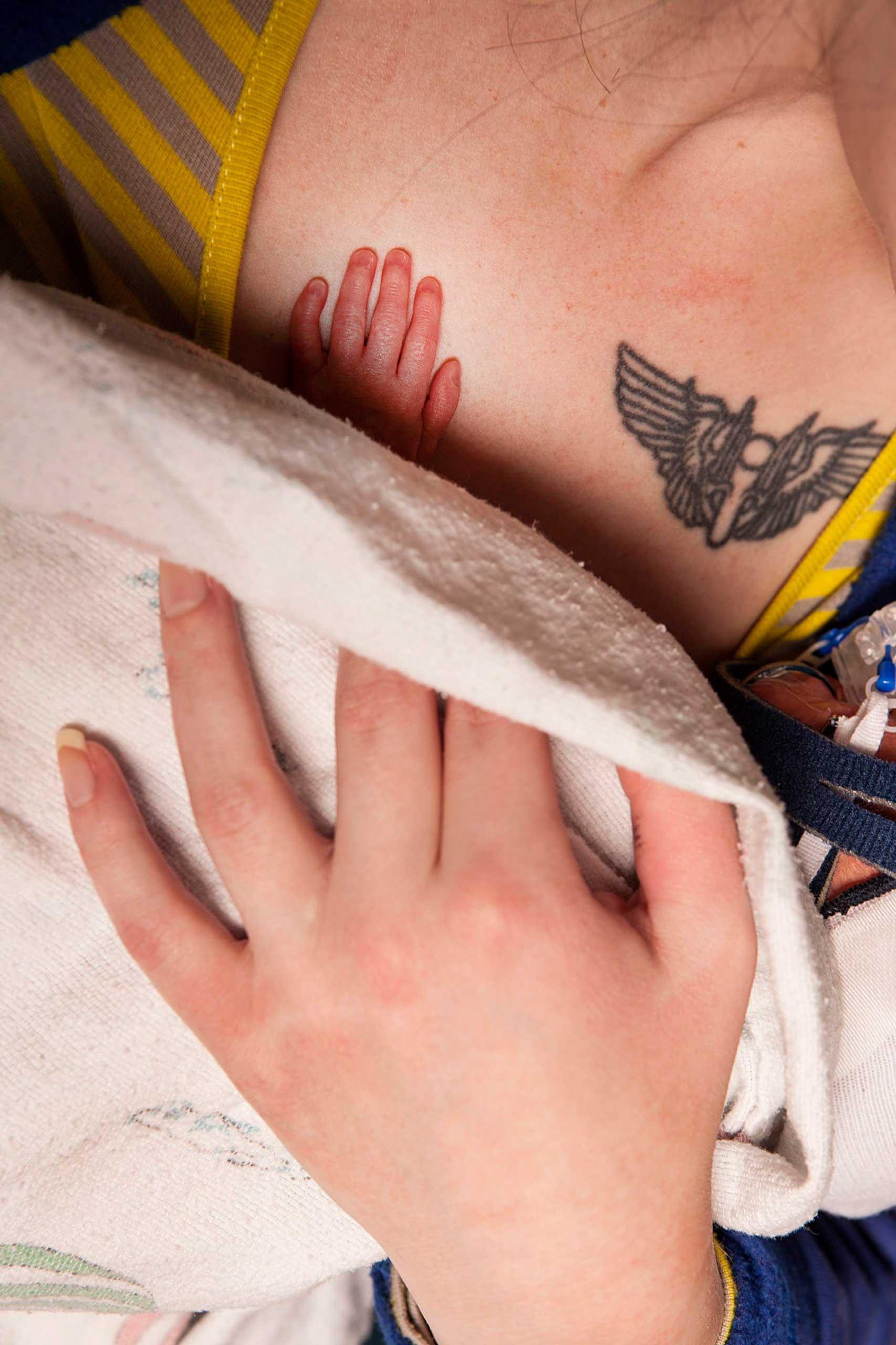 Melissa, David's mother, cradles him at the Children's Hospital of Wisconsin.