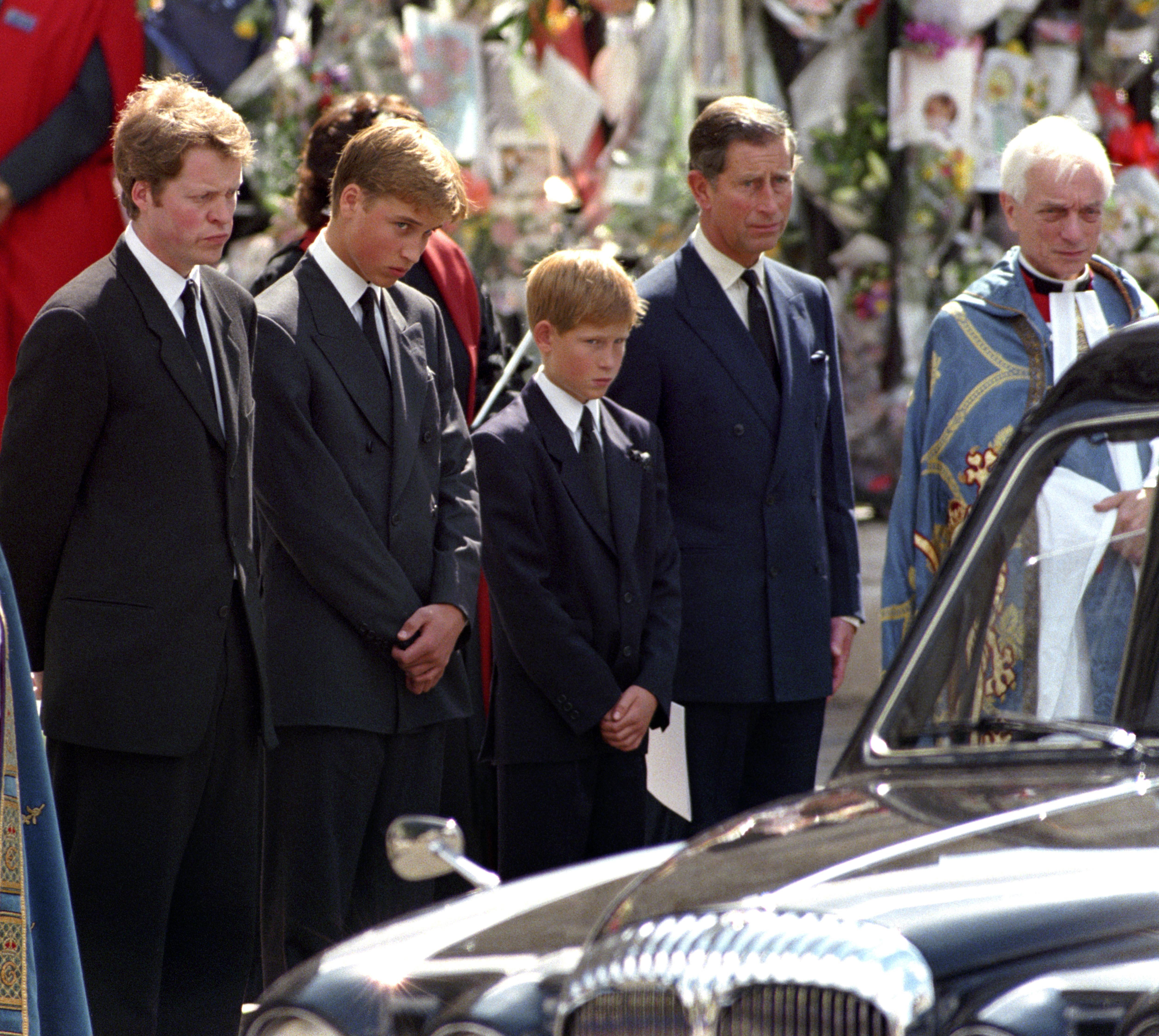 The Earl Spencer, Prince William, Prince Harry and the Prince of Wales, wait as the hearse carrying the coffin of Diana, Princess of Wales, prepares to leave Westminster Abbey following her funeral on Sept. 6, 1997.
