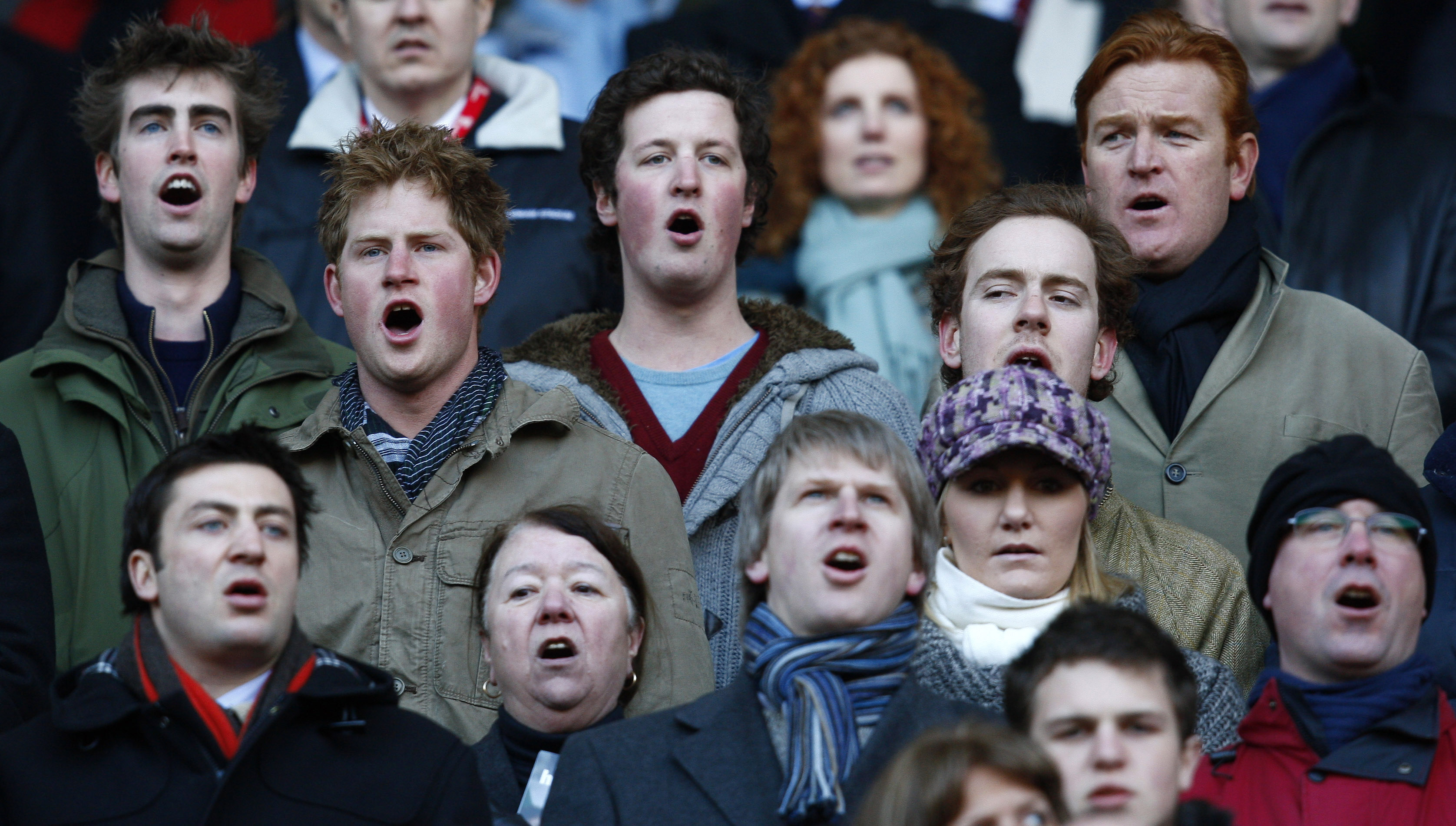 Britain's Prince Harry sings the national anthem before the Six Nations rugby match between England and Italy at Twickenham in London on Feb. 7, 2009.