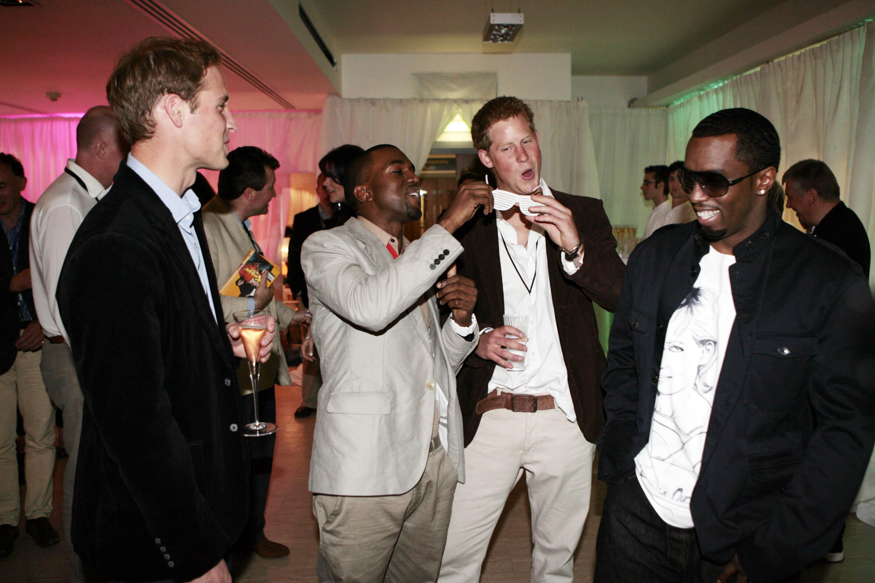 Britain's Prince William, singer Kanye West, Prince Harry and singer P. Diddy attend a reception after the concert in memory of Diana, Princess of Wales, at Wembley Stadium in London on July 1, 2007.