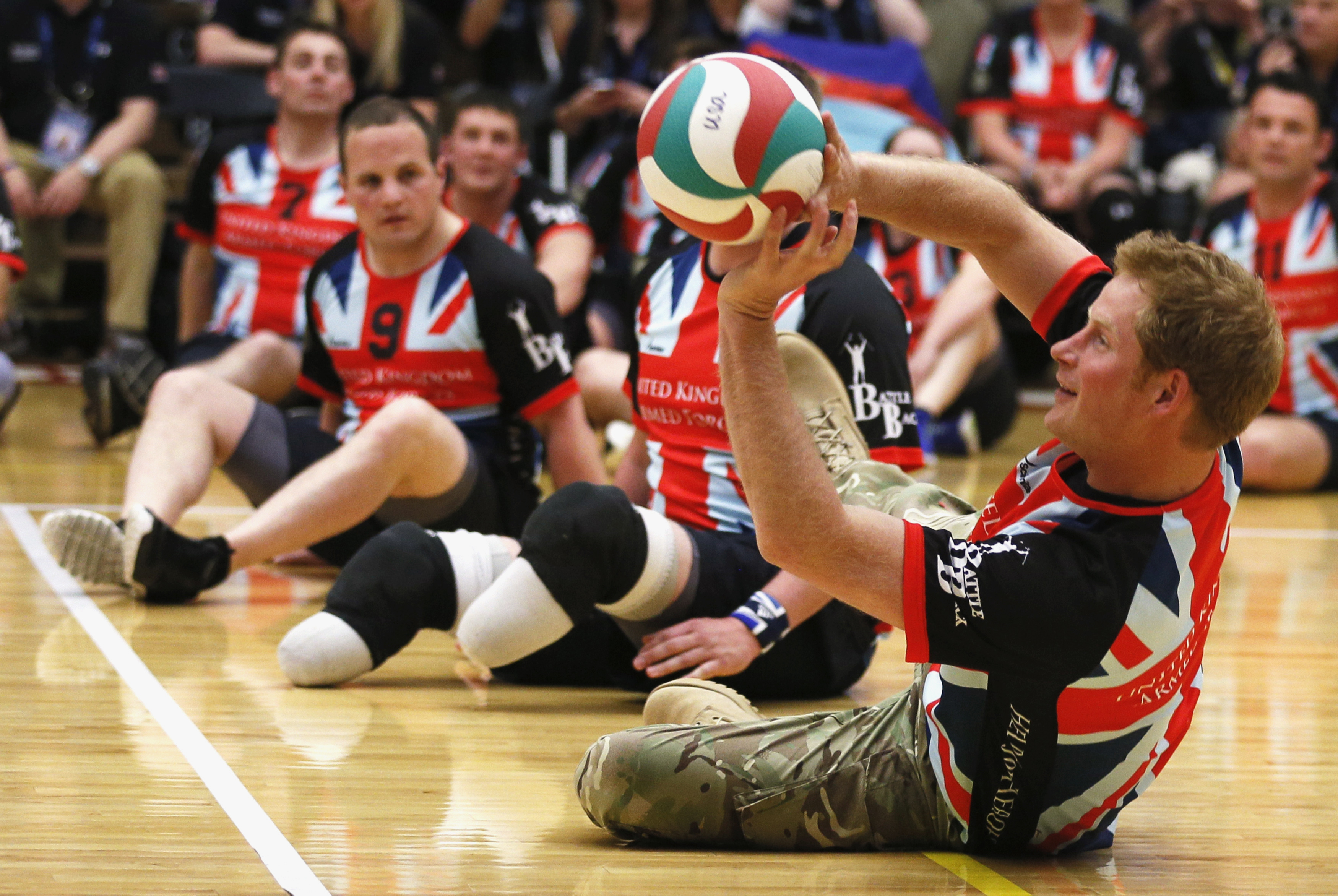 Britain's Prince Harry plays sitting volleyball with members of the British Warrior Games team in a gymnasium, before the opening of the Warrior Games at the U.S. Olympic Training Center in Colorado Springs, Colorado on May 11, 2013.