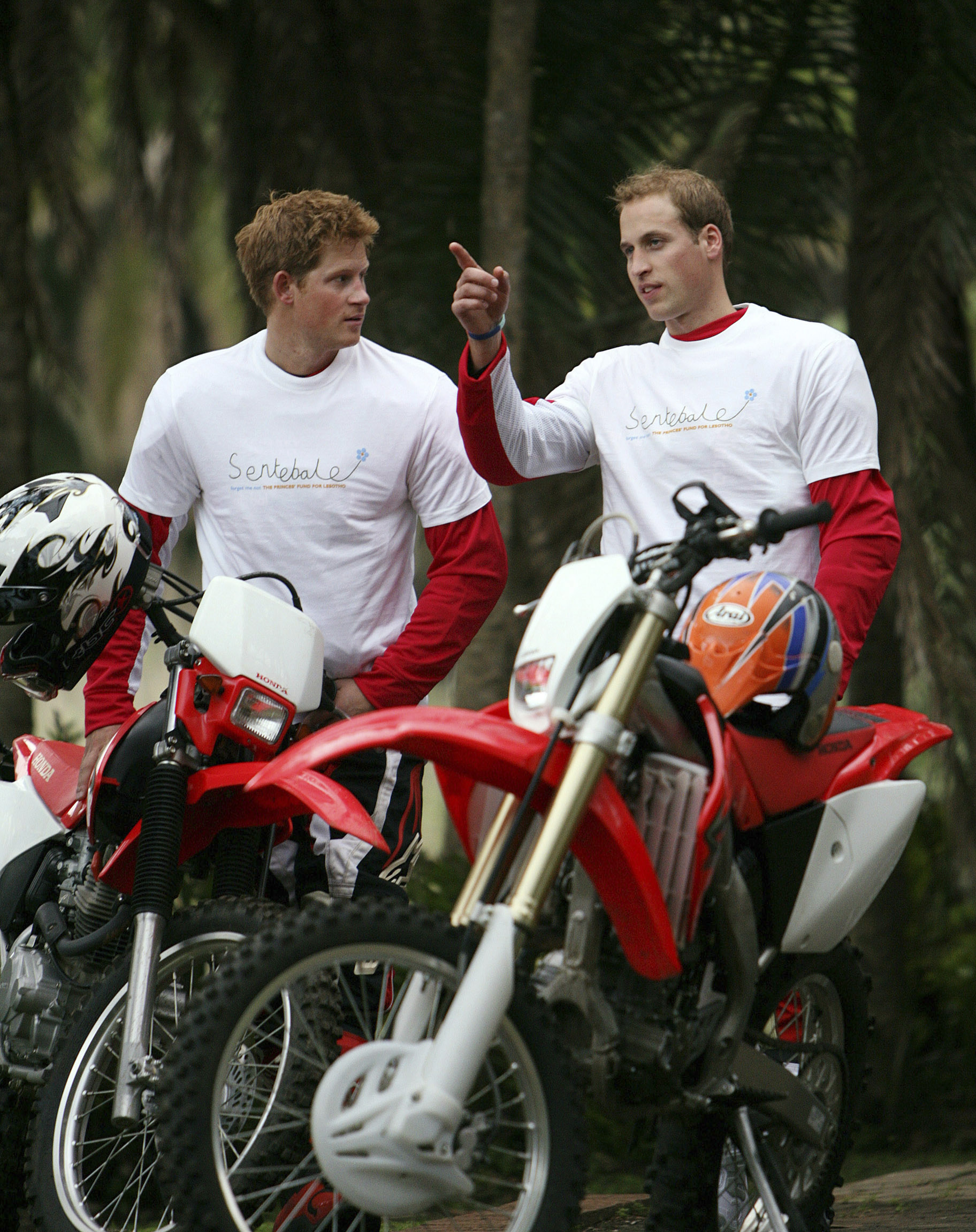 Prince William and Prince Harry stand with their motorcycles before the start of the Enduro Africa 08 charity motorcycle ride in Port Edward, about 93 miles) southwest of Durban on Oct. 17, 2008.