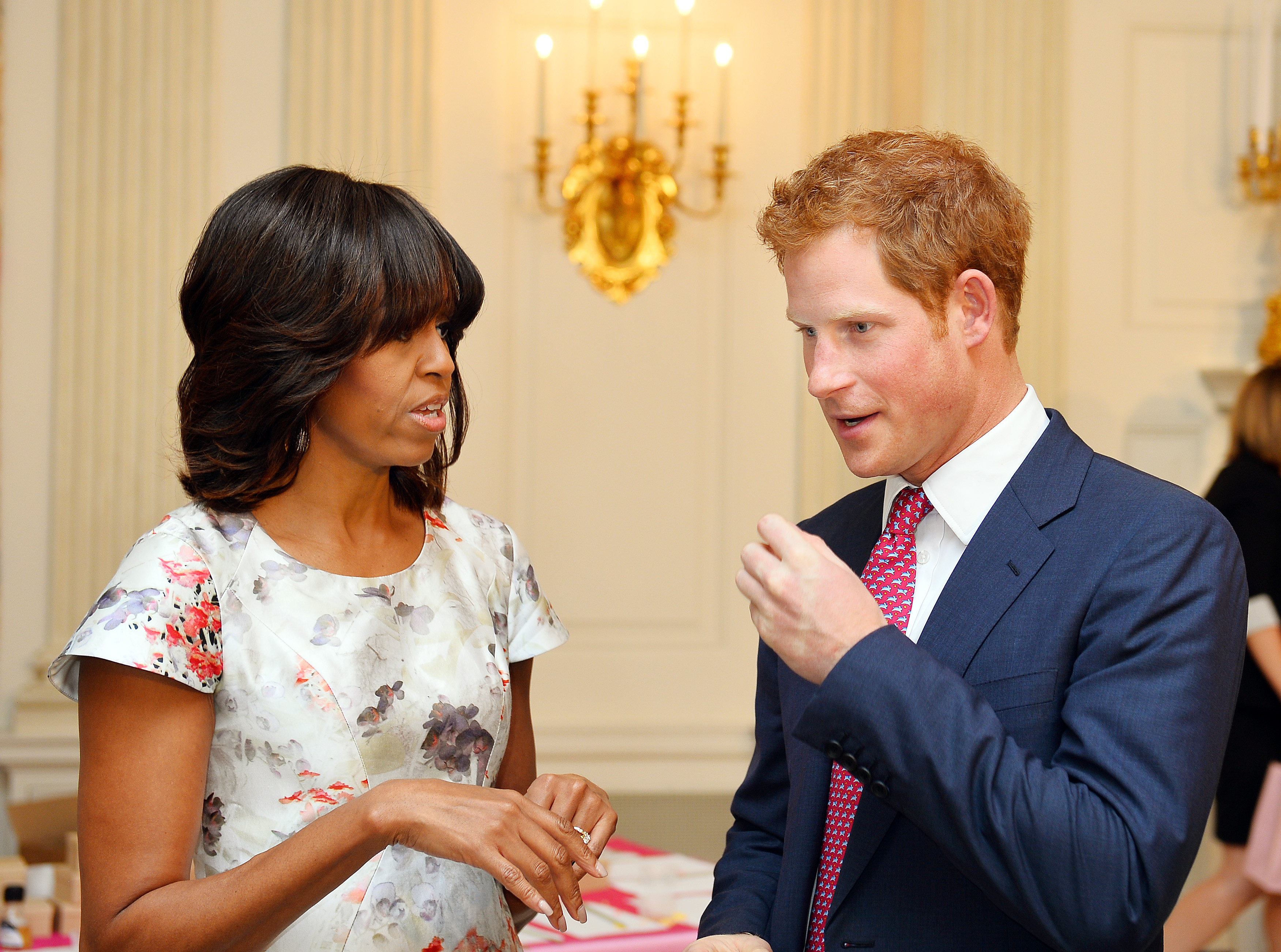 Prince Harry speaks with First Lady Michelle Obama during the first day of his visit to the United States on May 9, 2013 in Washington, D.C.