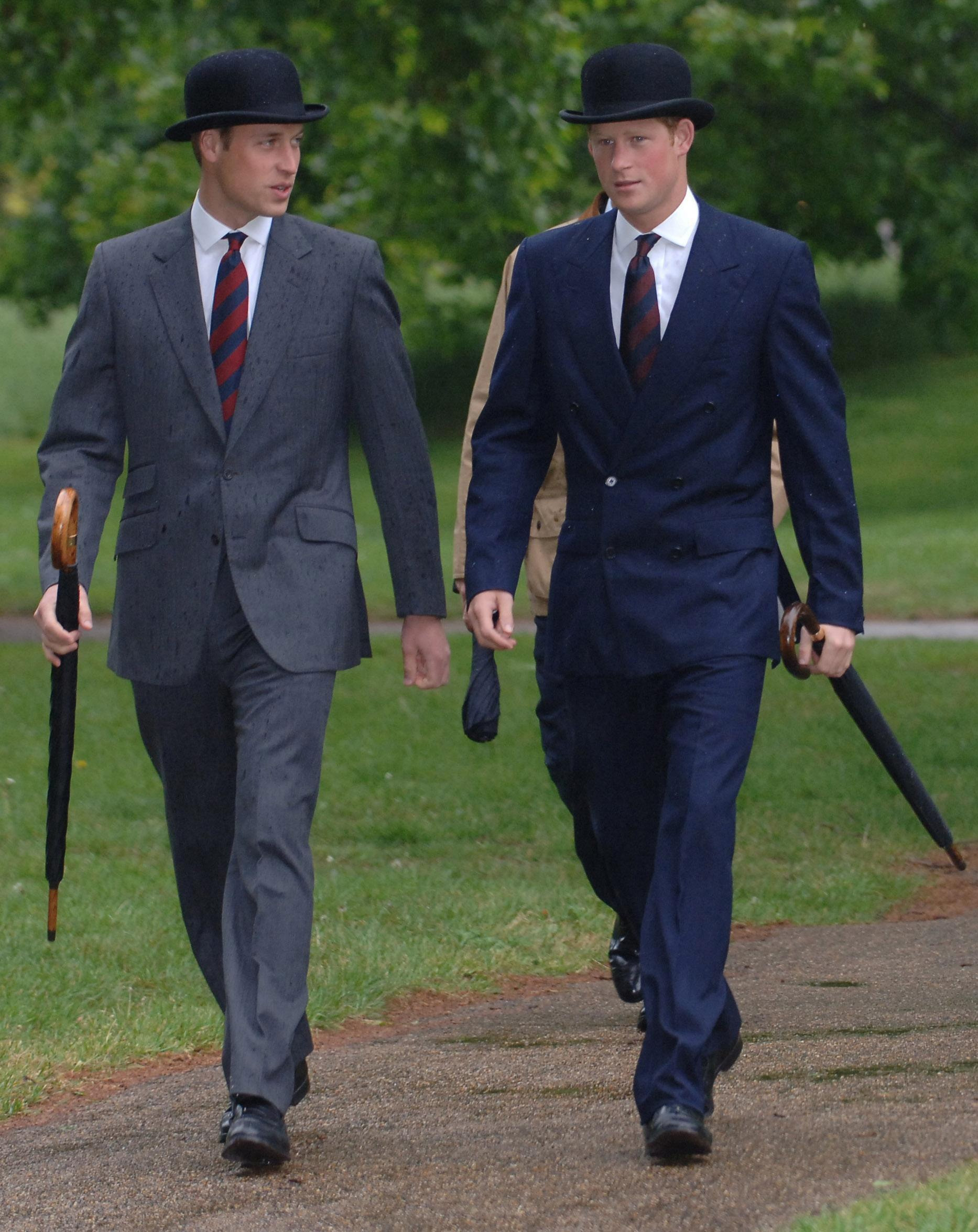 Prince William and Prince Harry, right, parade in suits and bowler hats with the Combined Cavalry Old Comrades' Association, in Hyde Park, London on May 13, 2007.