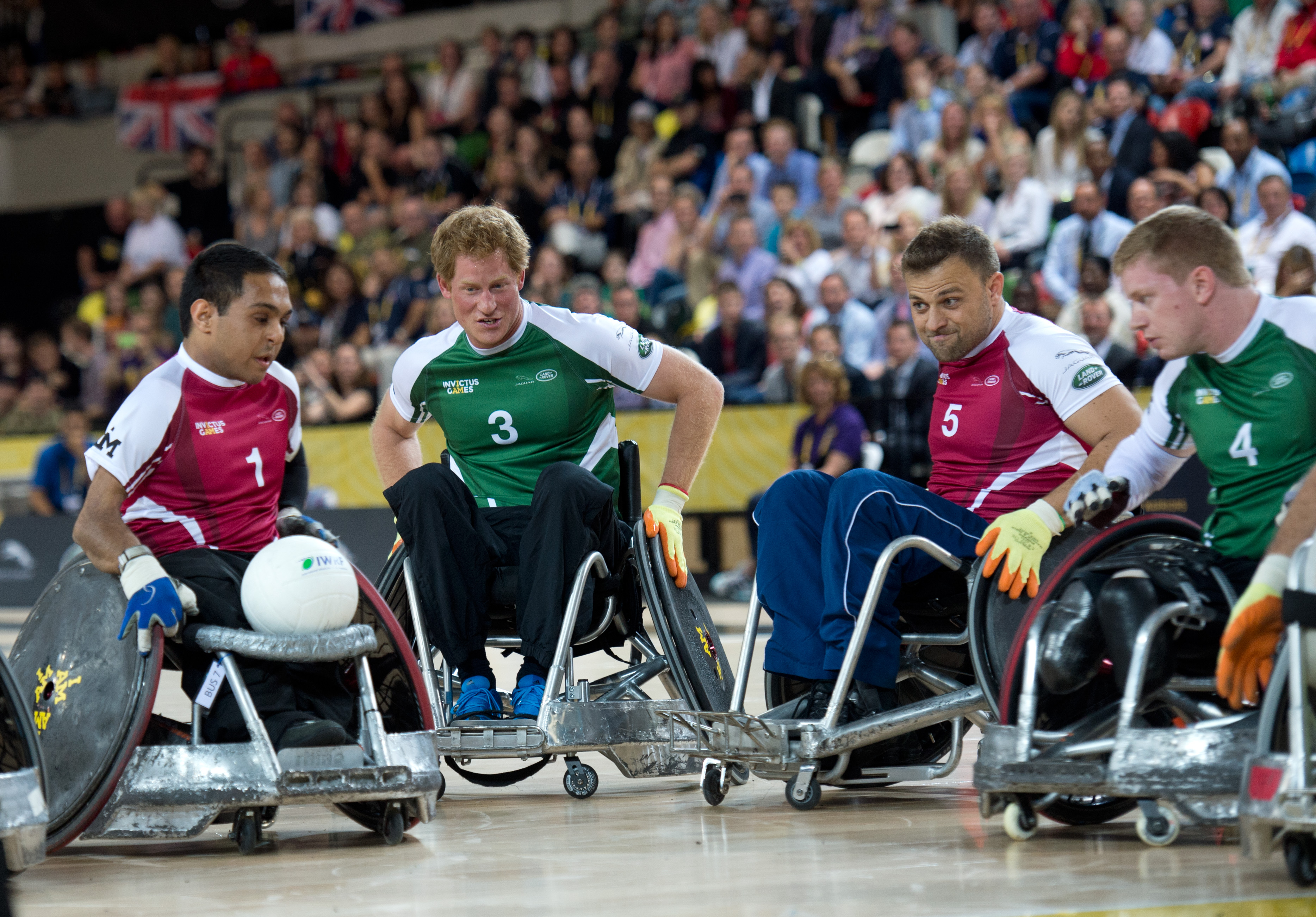 Prince Harry participates in a celebrity wheelchair rugby match on day 2 of the Invictus Games in London on Sept. 12, 2014.