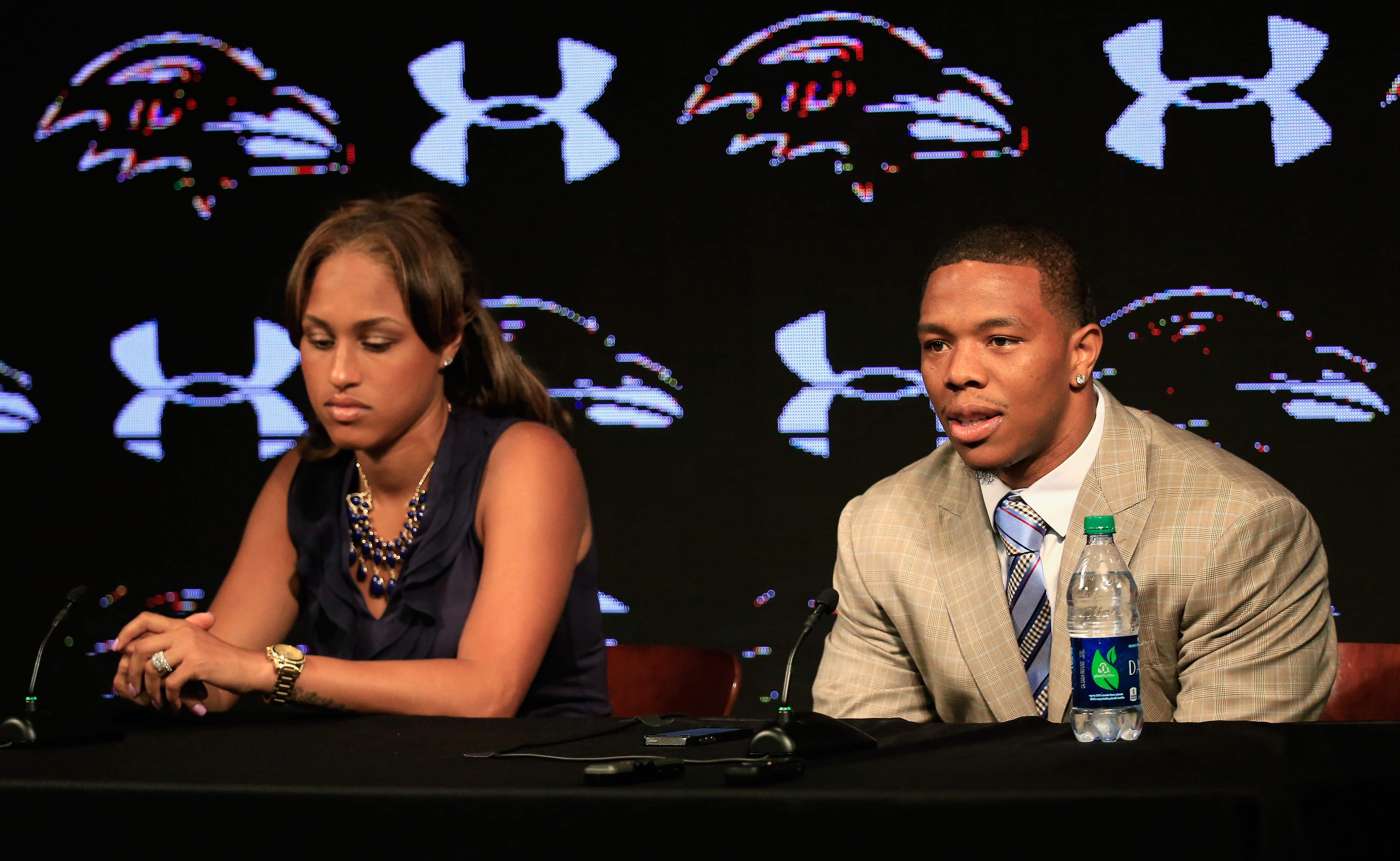 Running back Ray Rice of the Baltimore Ravens addresses a news conference with his wife Janay at the Ravens training center on May 23, 2014 in Owings Mills, Maryland.