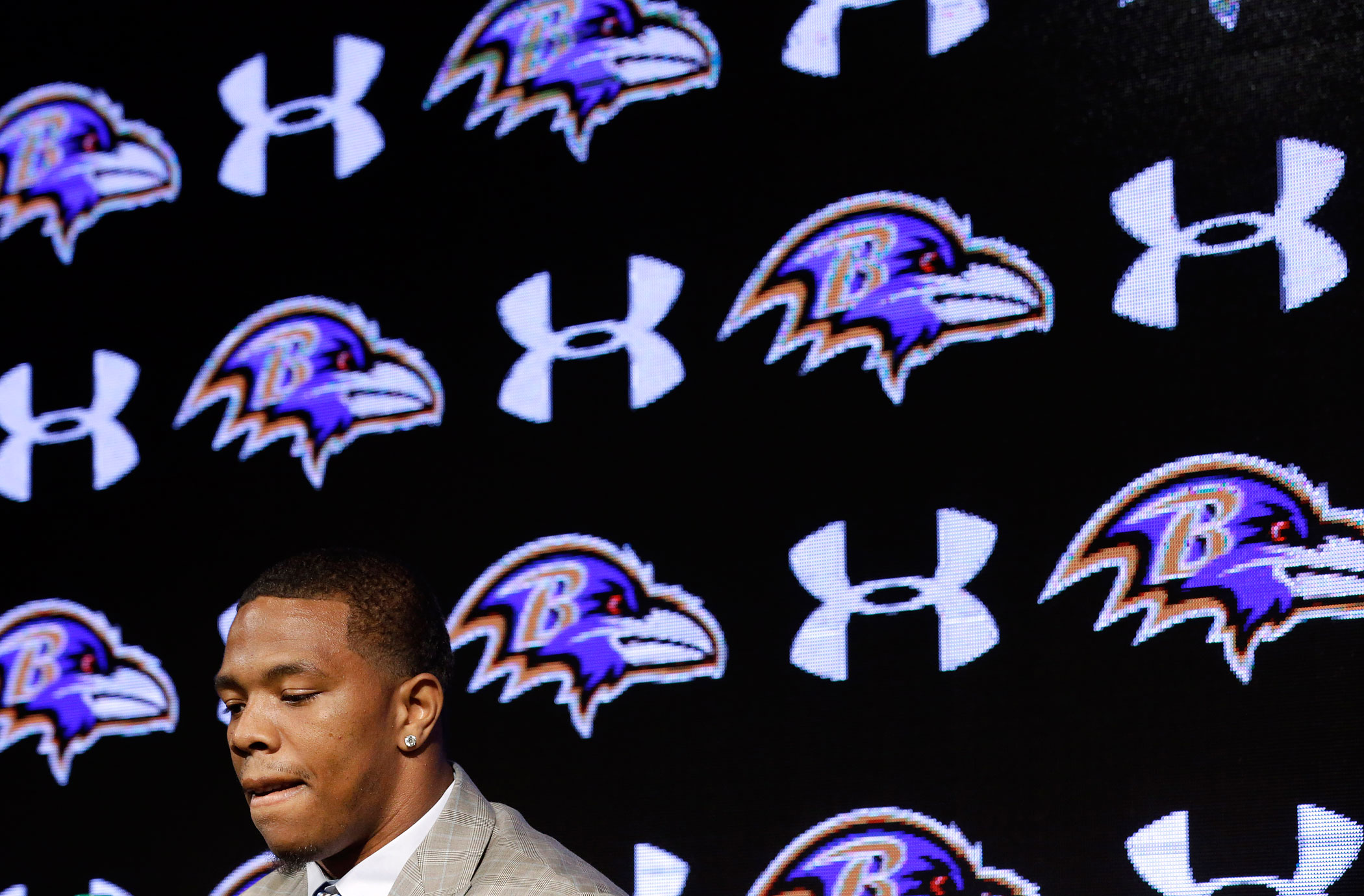 Baltimore Ravens running back Ray Rice pauses as he speaks during an NFL football news conference, Friday, May 23, 2014, in Owings Mills, Md.
