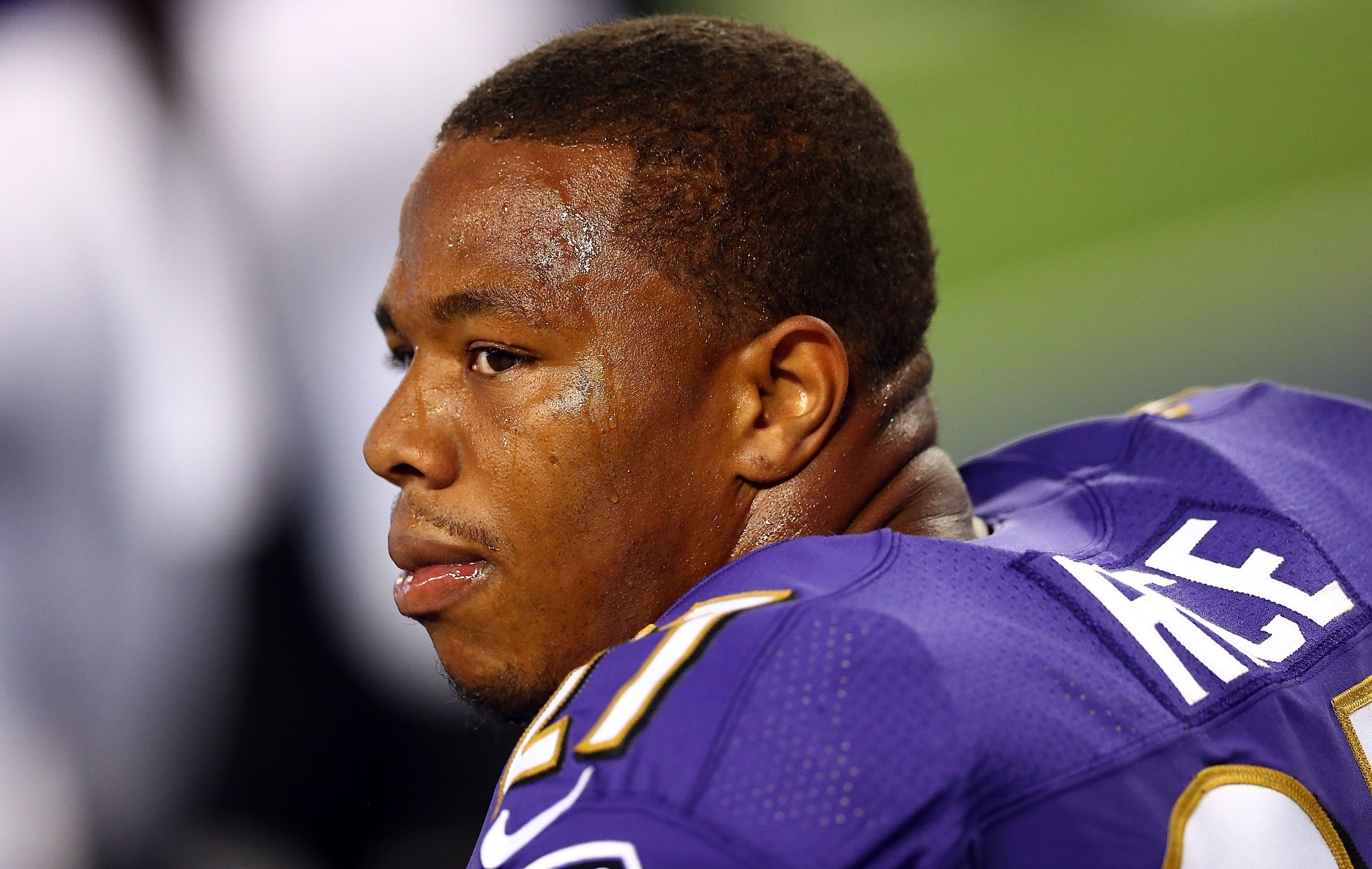 Ray Rice of the Baltimore Ravens sits on the bench against the Dallas Cowboys in the first half of their preseason game on Aug. 16, 2014 in Arlington, Texas.