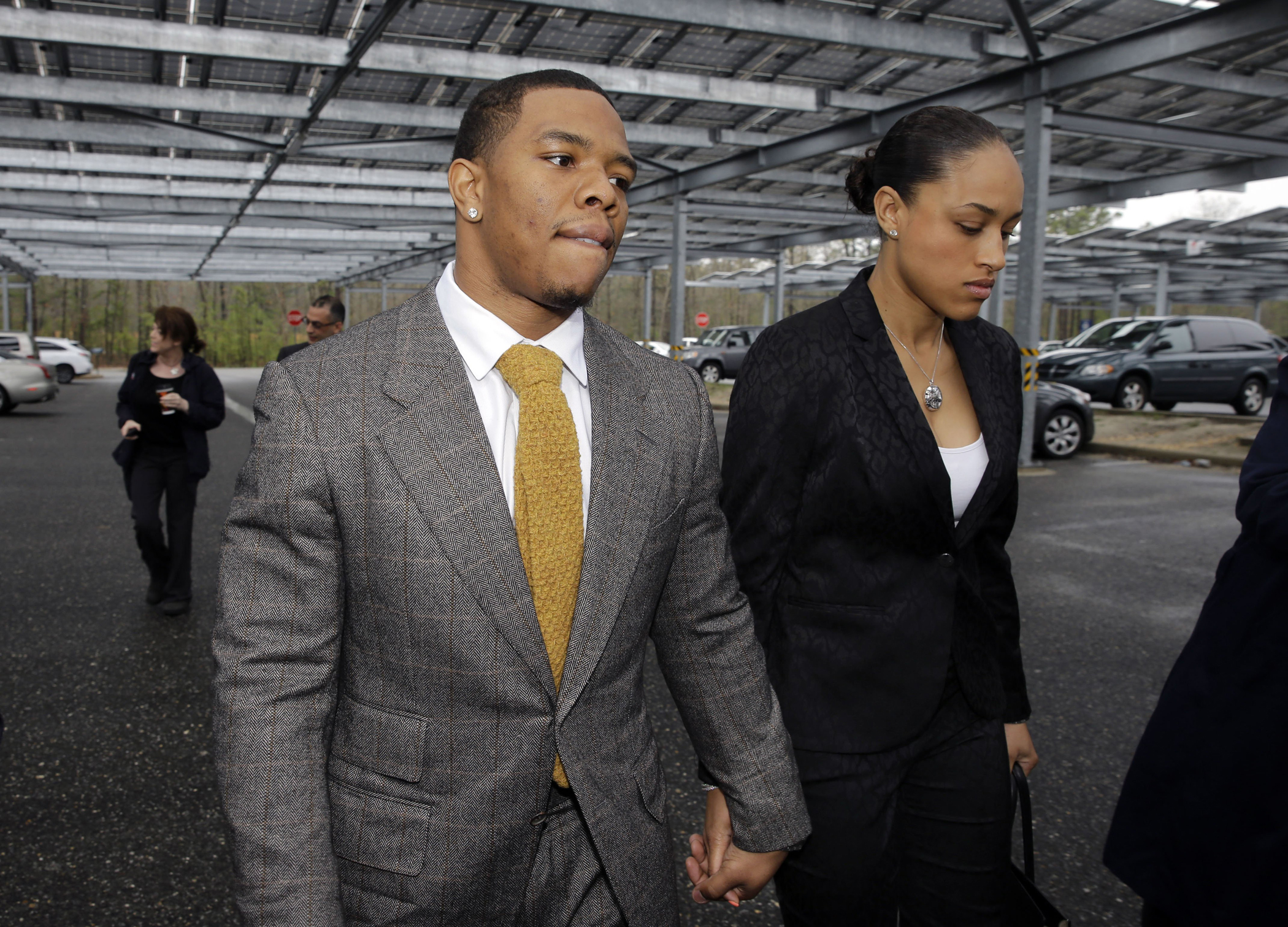 Baltimore Ravens football player Ray Rice holds hands with his wife, Janay Palmer, as they arrive at Atlantic County Criminal Courthouse in Mays Landing, N.J., in May 2014.