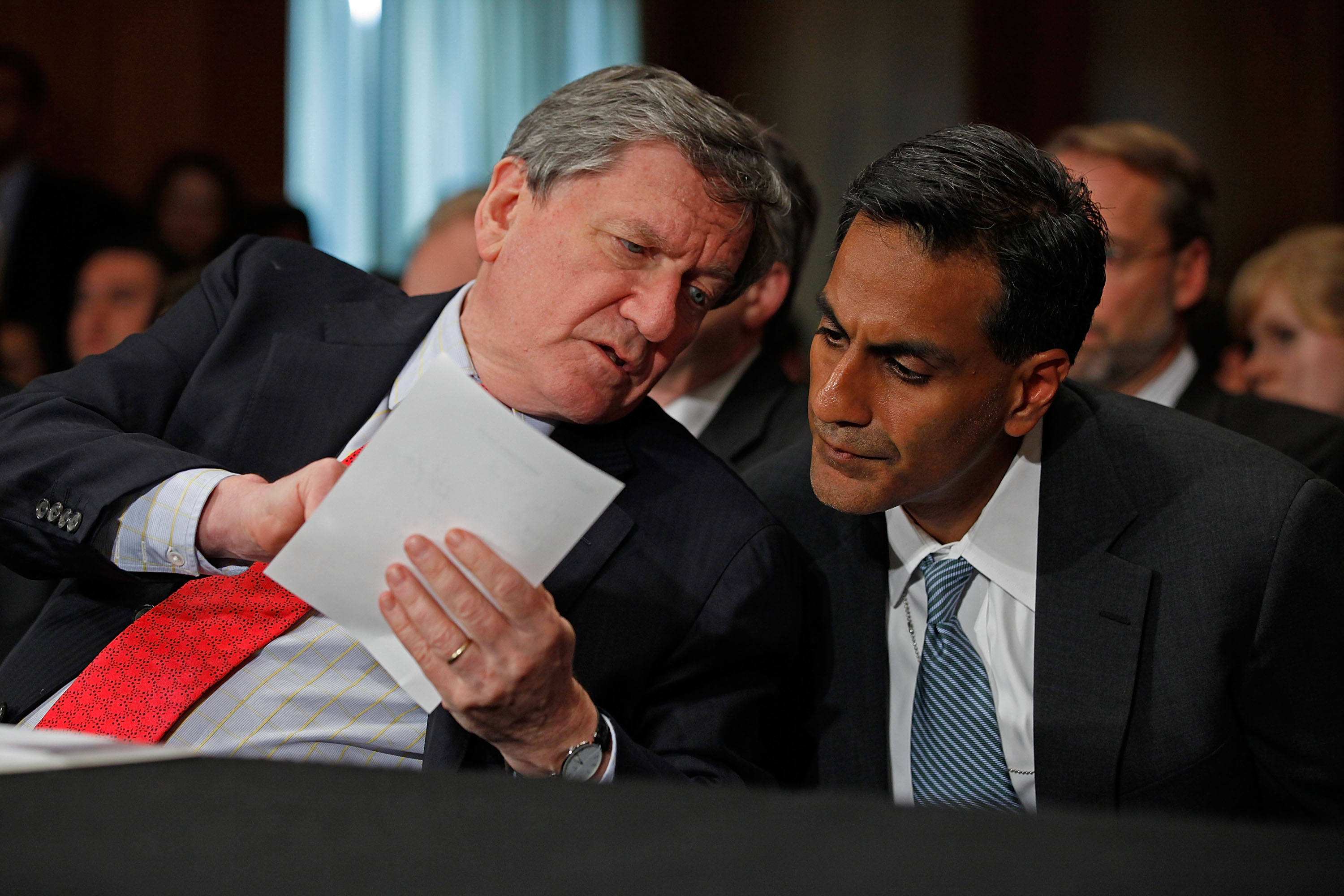 Richard Verma in conversation with the late Richard Holbrooke, U.S. special representative for Afghanistan and Pakistan, while the latter testified before the Senate Foreign Relations Committee on Capitol Hill, in Washington, D.C., on July 14, 2010