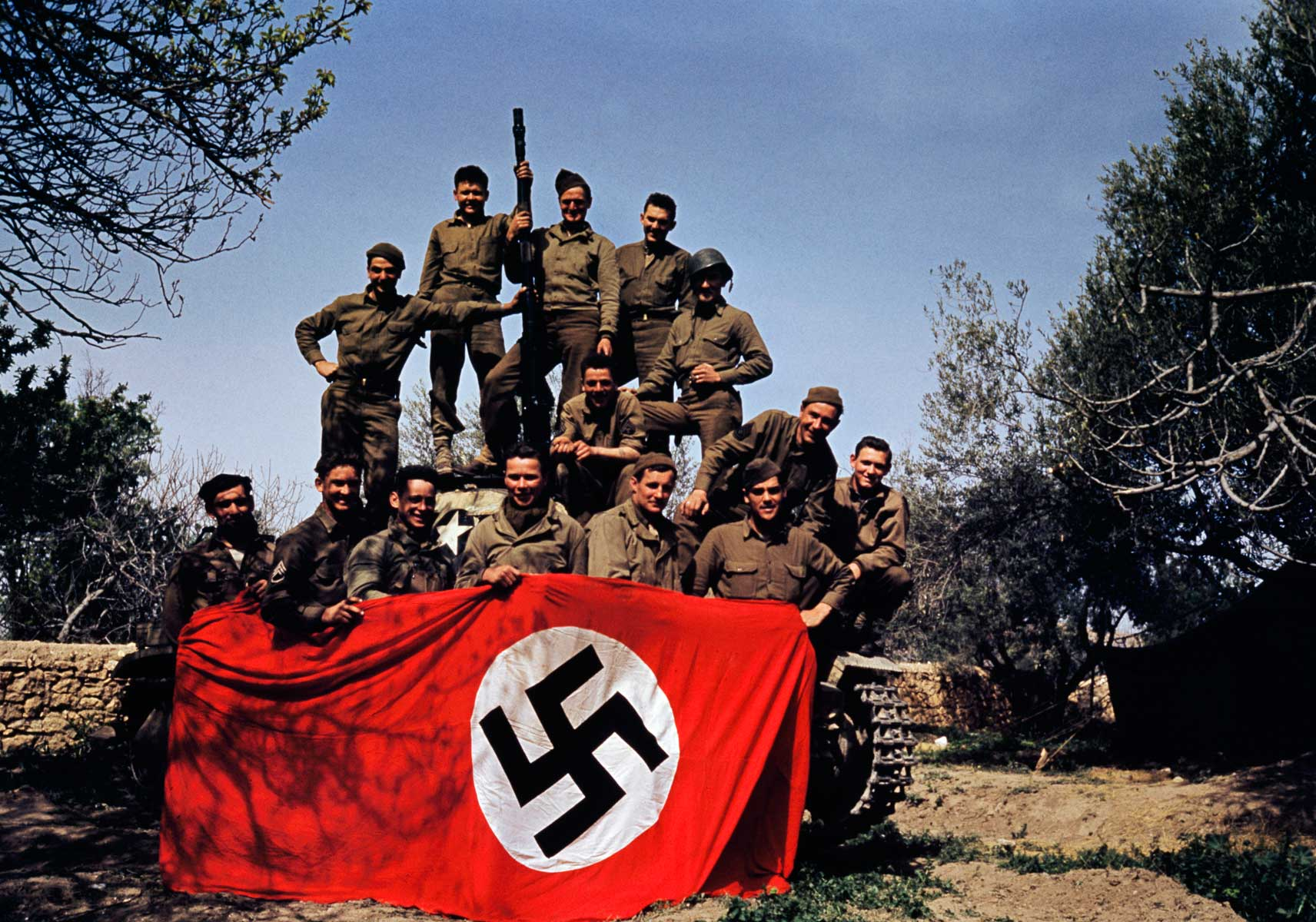 Members of an American armored division posing with a tank, Tunisia, May 1943.