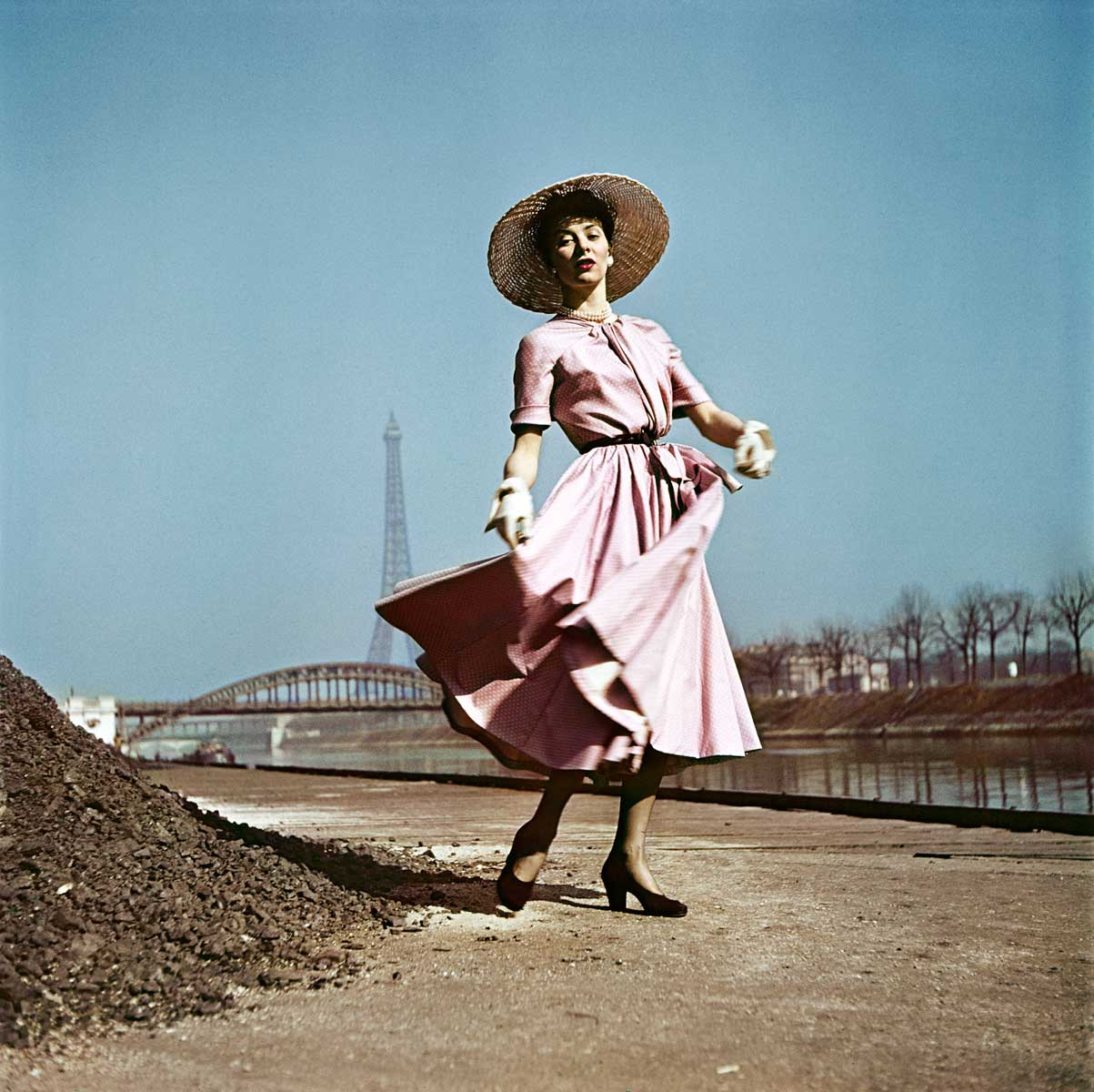 Model wearing Dior on the banks of the Seine, Paris, 1948.