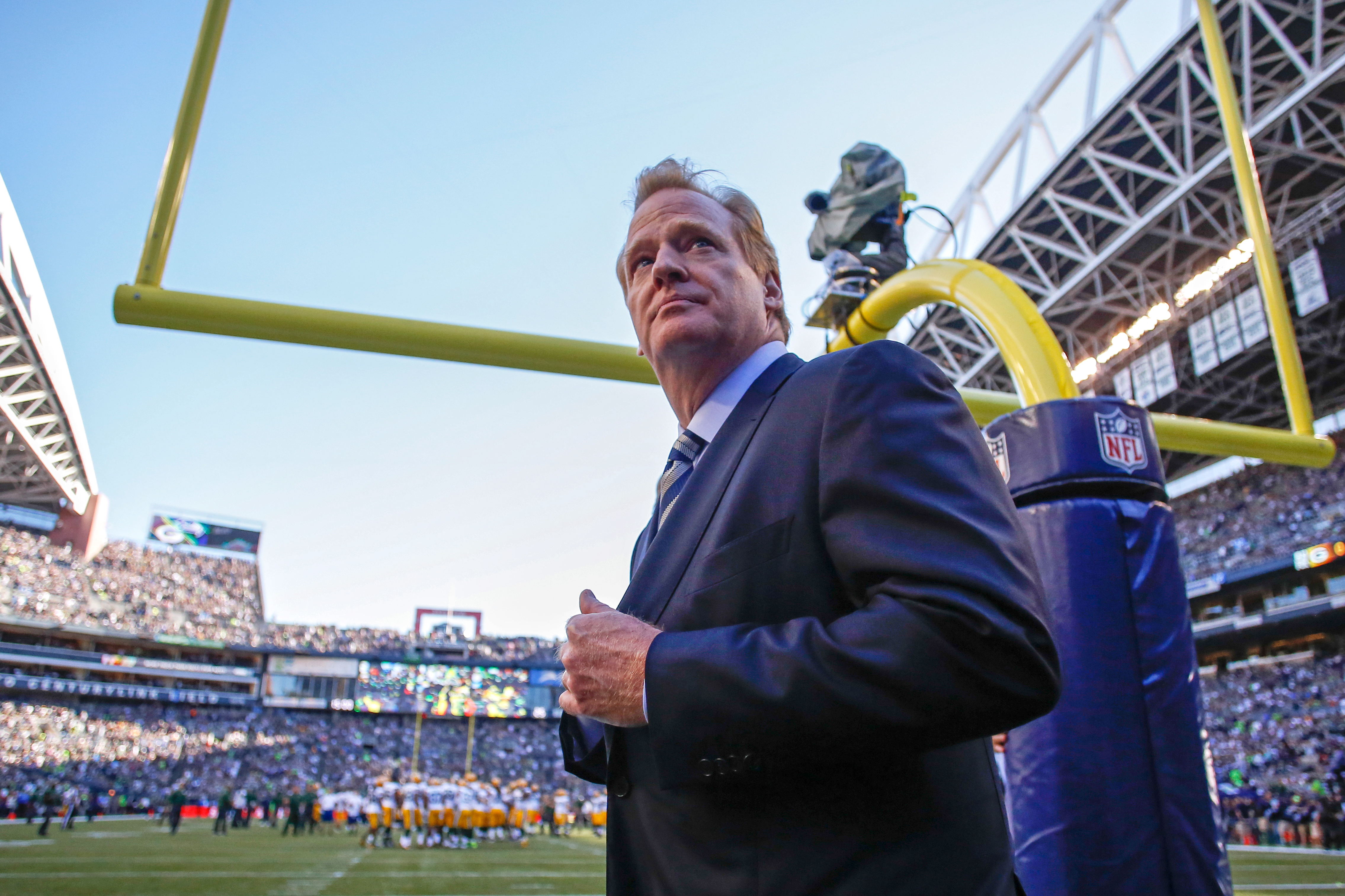 NFL commissioner Roger Goodell walks the sidelines prior to the game between the Seattle Seahawks and the Green Bay Packers at CenturyLink Field in Seattle on Sept. 4, 2014