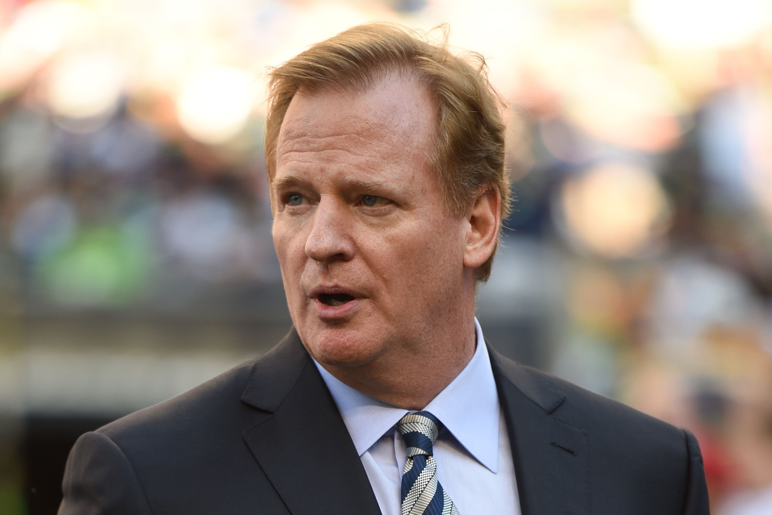 NFL commissioner Roger Goodell walks the sidelines before the game between the Seattle Seahawks and the Green Bay Packers at CenturyLink Field on Sept. 4, 2014 in Seattle.