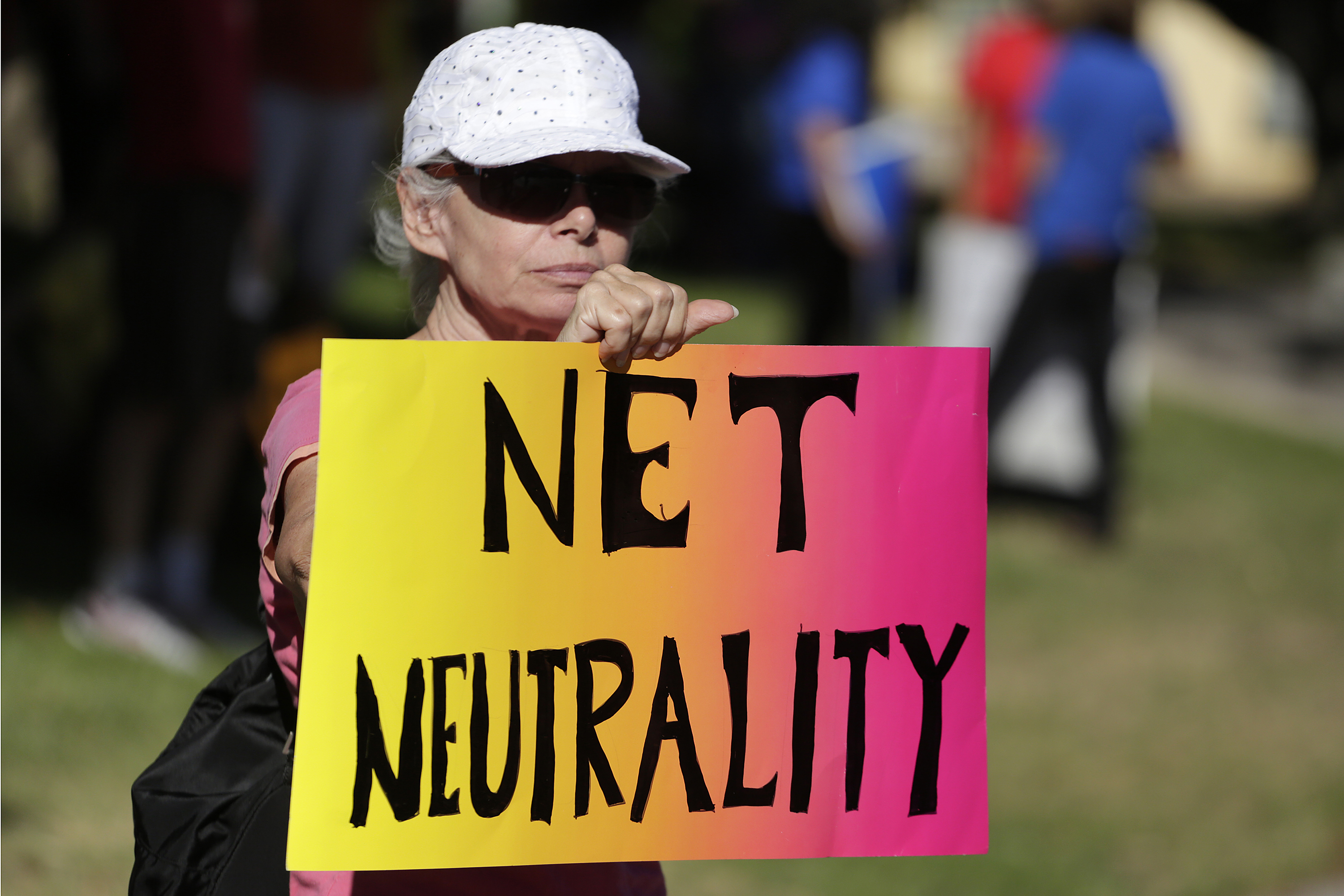 A protester attends a net-neutrality rally in Los Angeles on July 23, 2014