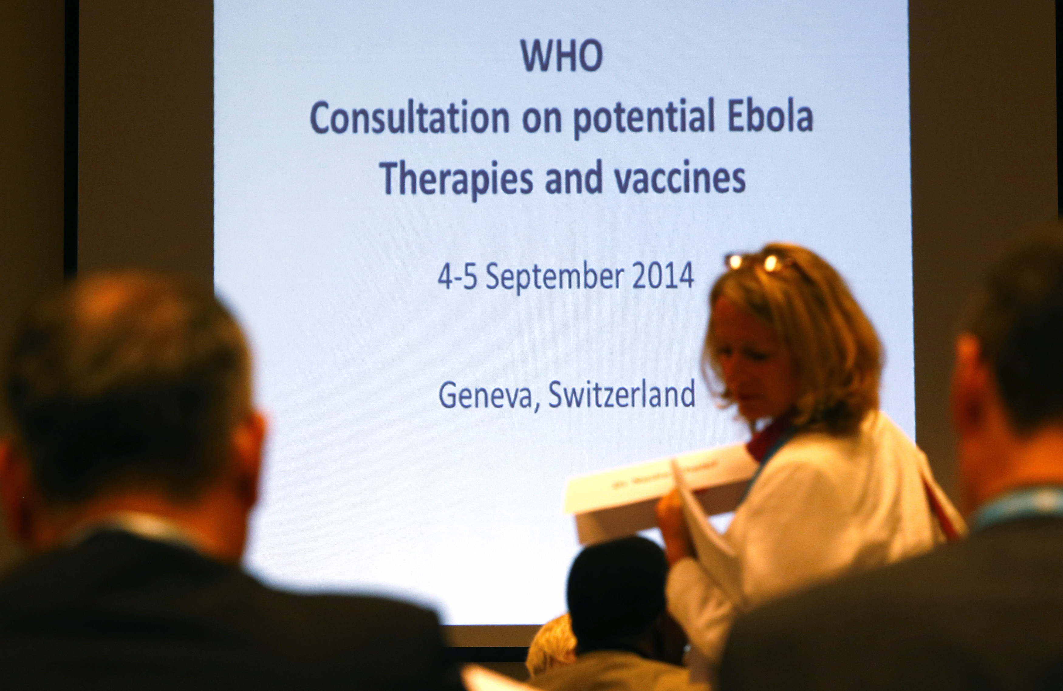 Participants arrive at the opening of a consultation of international experts on potential Ebola therapies and vaccines in Geneva September 4, 2014.
