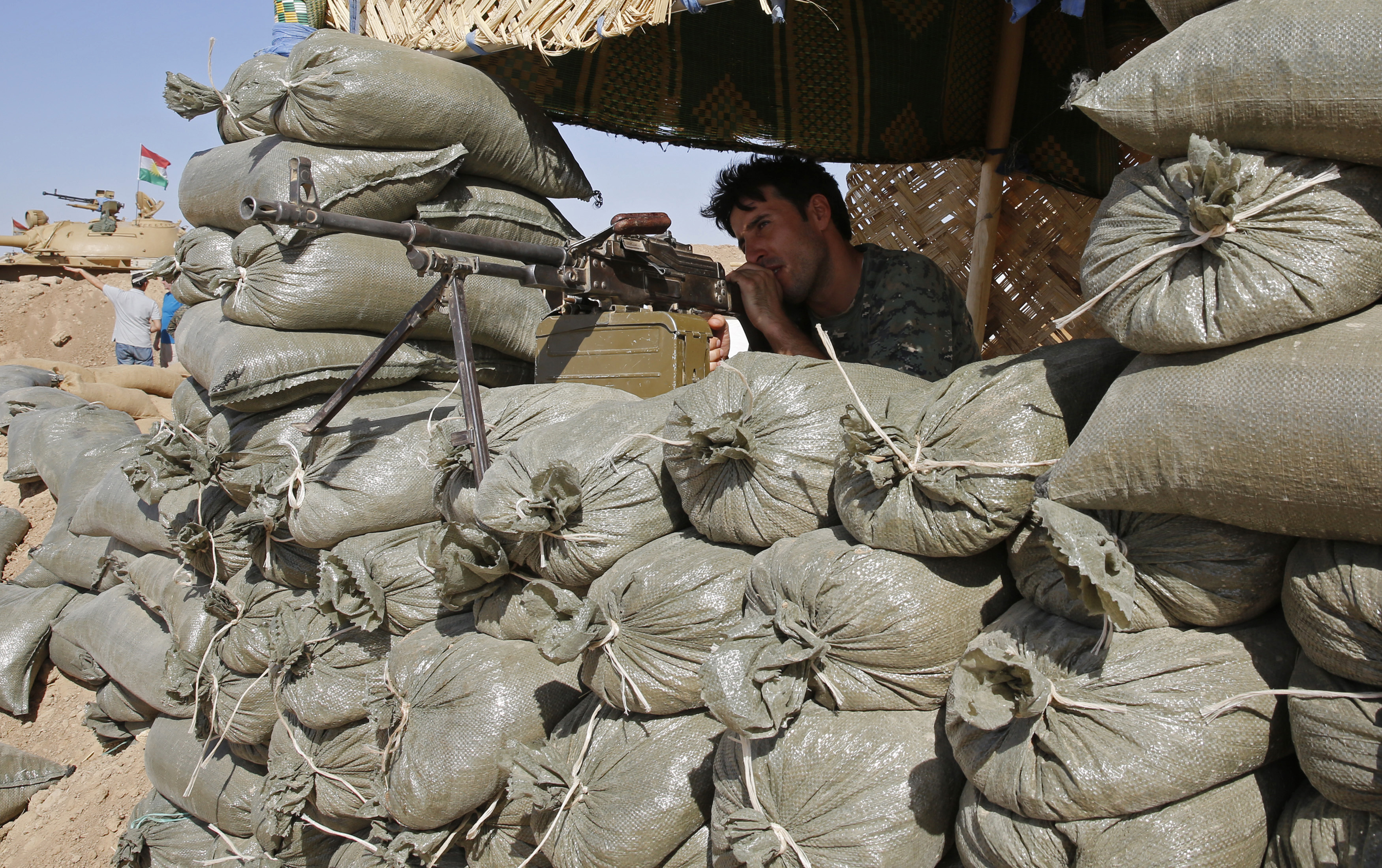 A Kurdish fighter primed for action against ISIS in the northern Iraq town of Khazir on Sunday.
