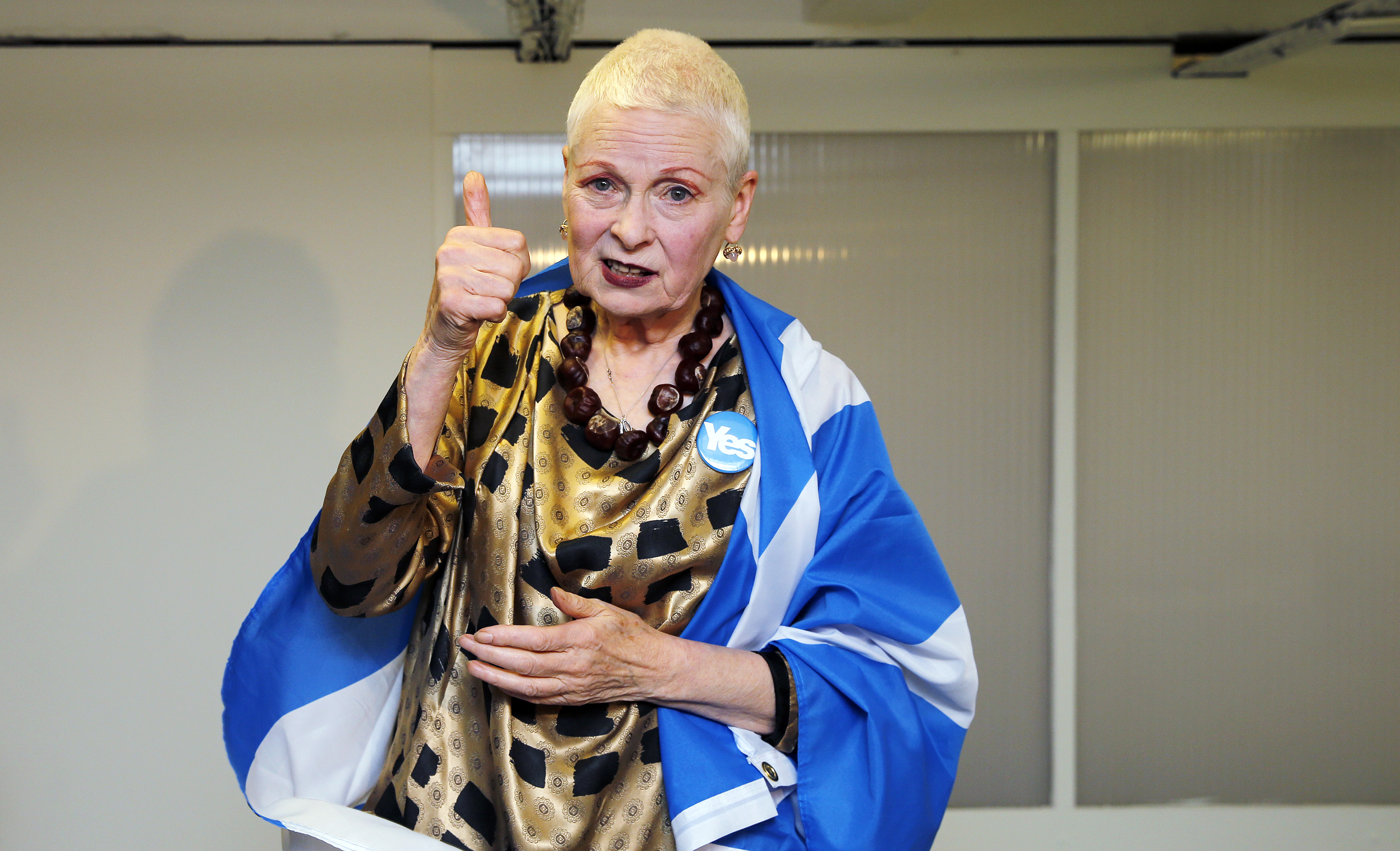 Vivienne Westwood wears a  YES  badge and Scottish flag backstage before the presentation of her Vivienne Westwood Red Label Spring/Summer 2015 collection during London Fashion Week on Sept. 14, 2014.